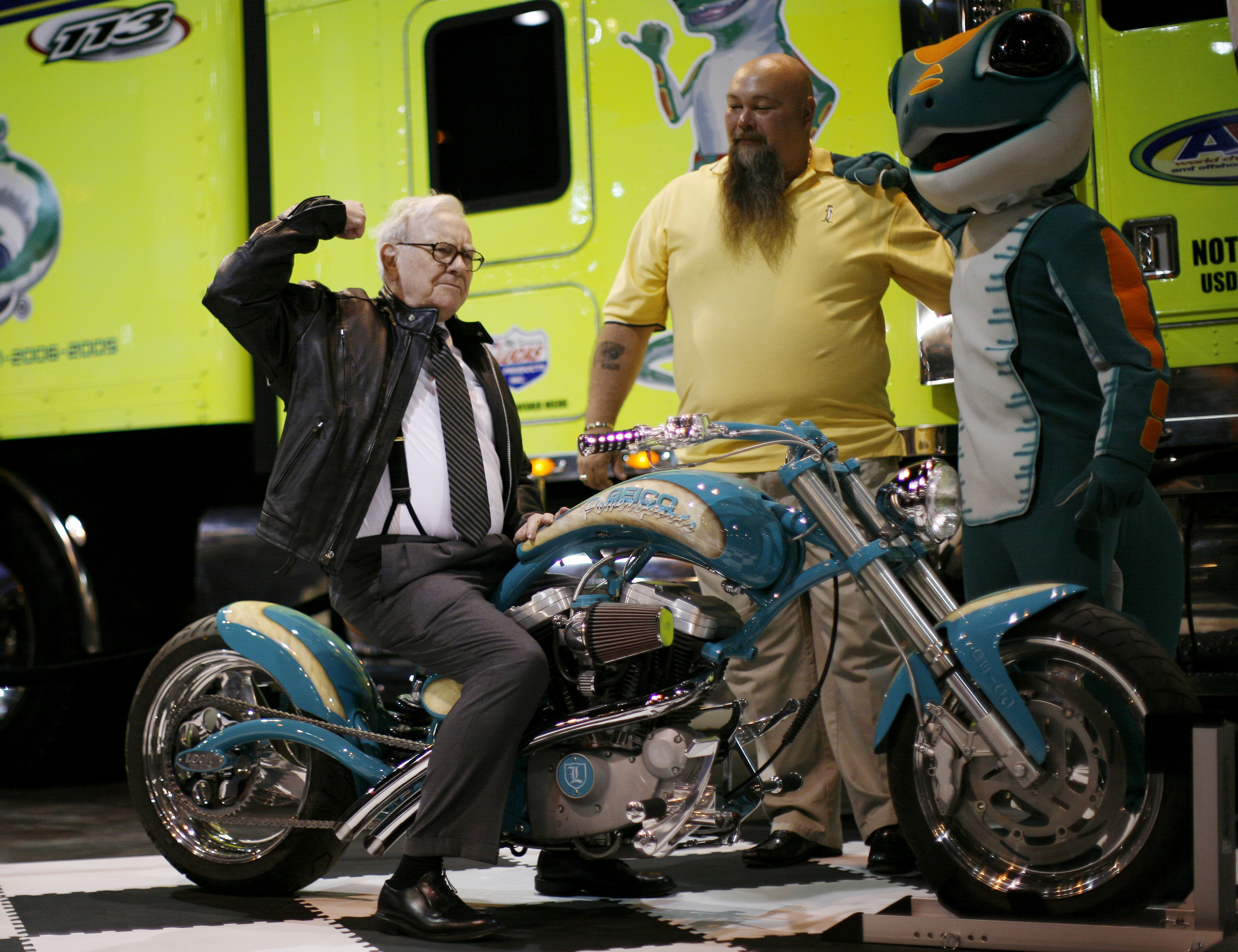 Billionaire financier and Berkshire Hathaway CEO Warren Buffett poses on a motorcycle during Berkshire Hathaway Annual Shareholders meeting in Omaha