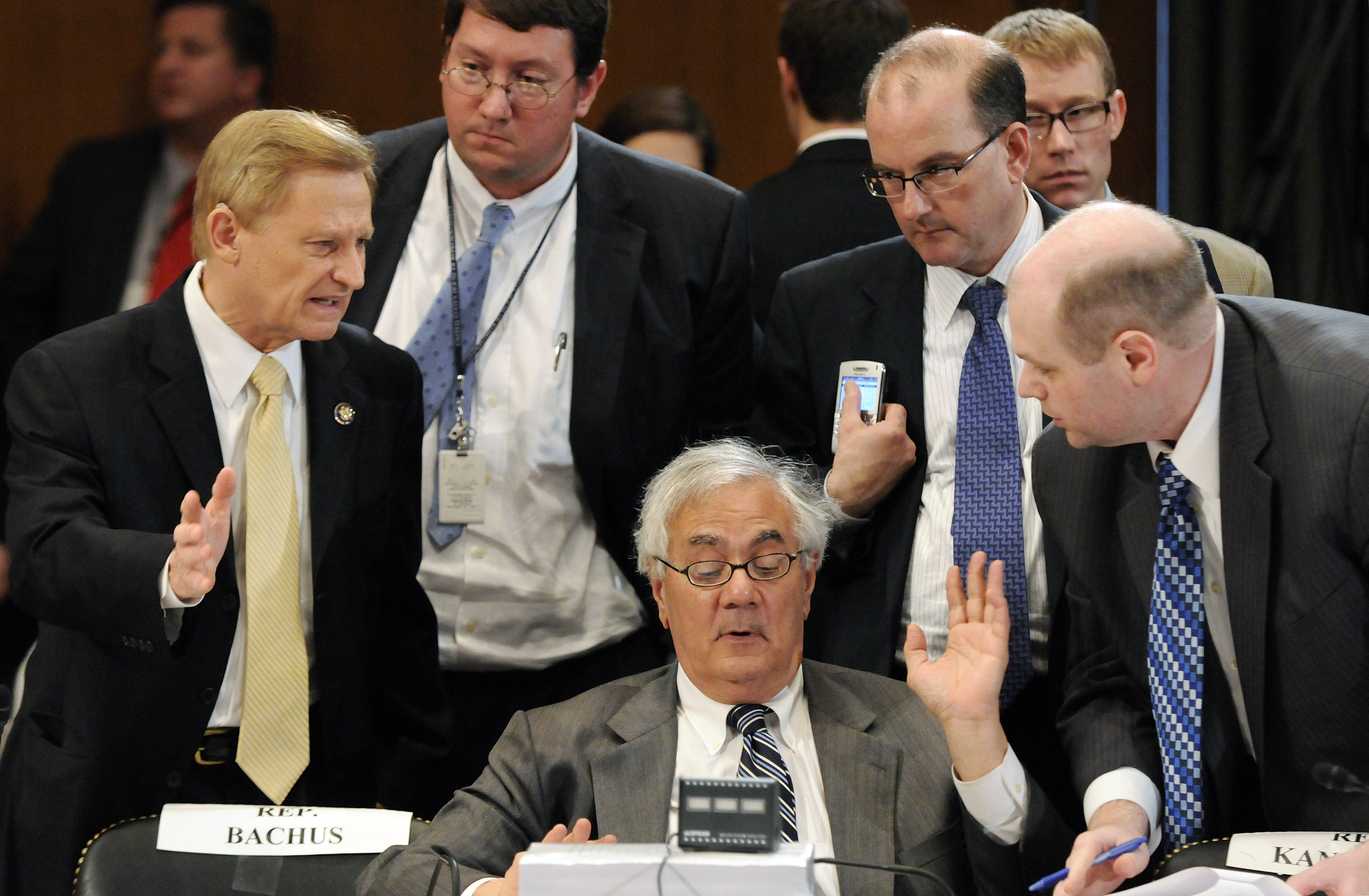 Frank talks with a group including Bachus during a recess from a committee conference on Wall Street reform on Capitol Hill