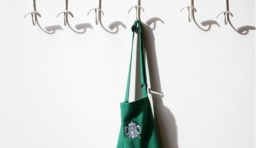 A barrista's apron hangs on a peg in Starbucks' Mayfair Vigo Street branch in central London