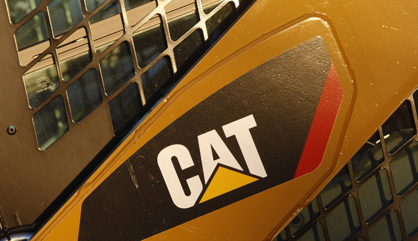 The CAT logo is seen on the side of a Caterpillar machine on a lot at Milton CAT in North Reading, Massachusetts