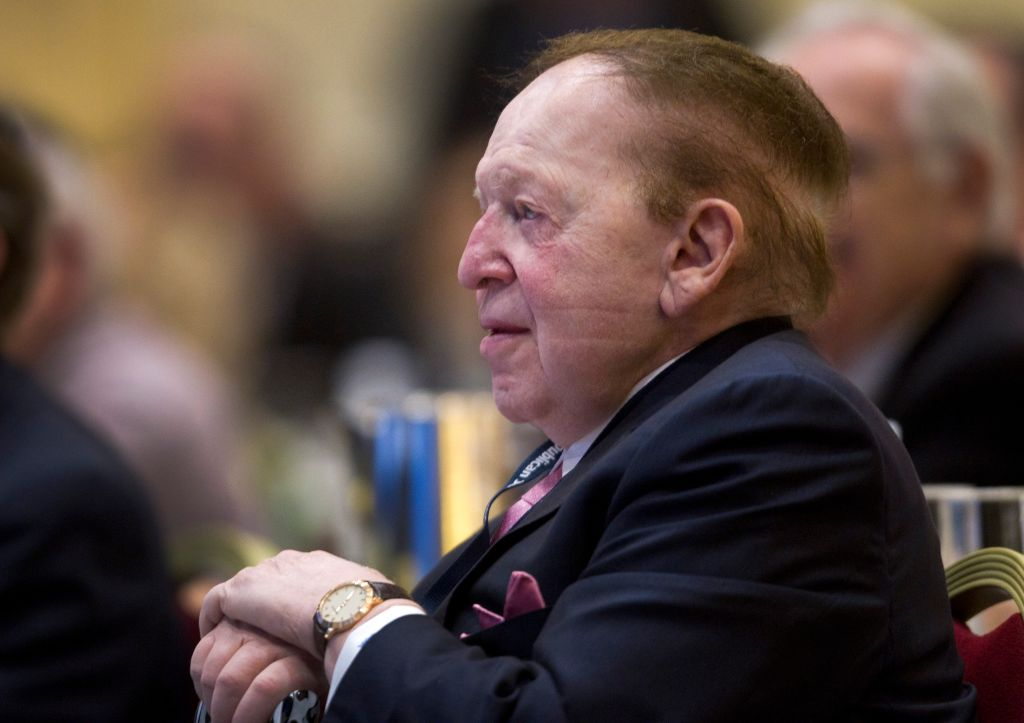 Adelson, chairman of the board and chief executive officer of Las Vegas Sands Corp., listens to New Jersey Governor Chris Christie during the Republican Jewish Coalition Spring Leadership Meeting at the Venetian Resort in Las Vegas