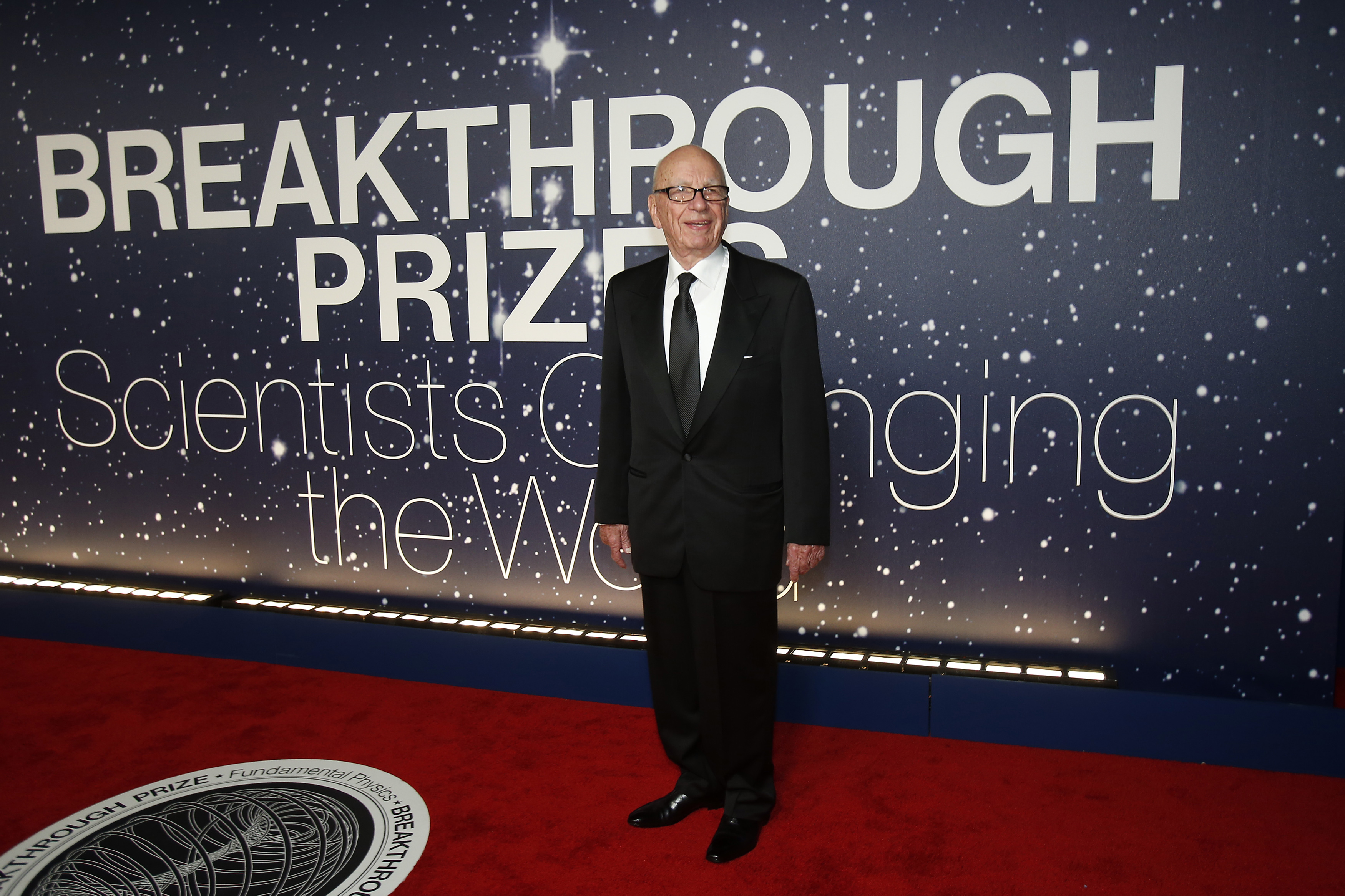 Executive Chairman of News Corp and Chairman and CEO of 21st Century Fox Murdoch arrives on the red carpet during the second annual Breakthrough Prize Awards in Mountain View