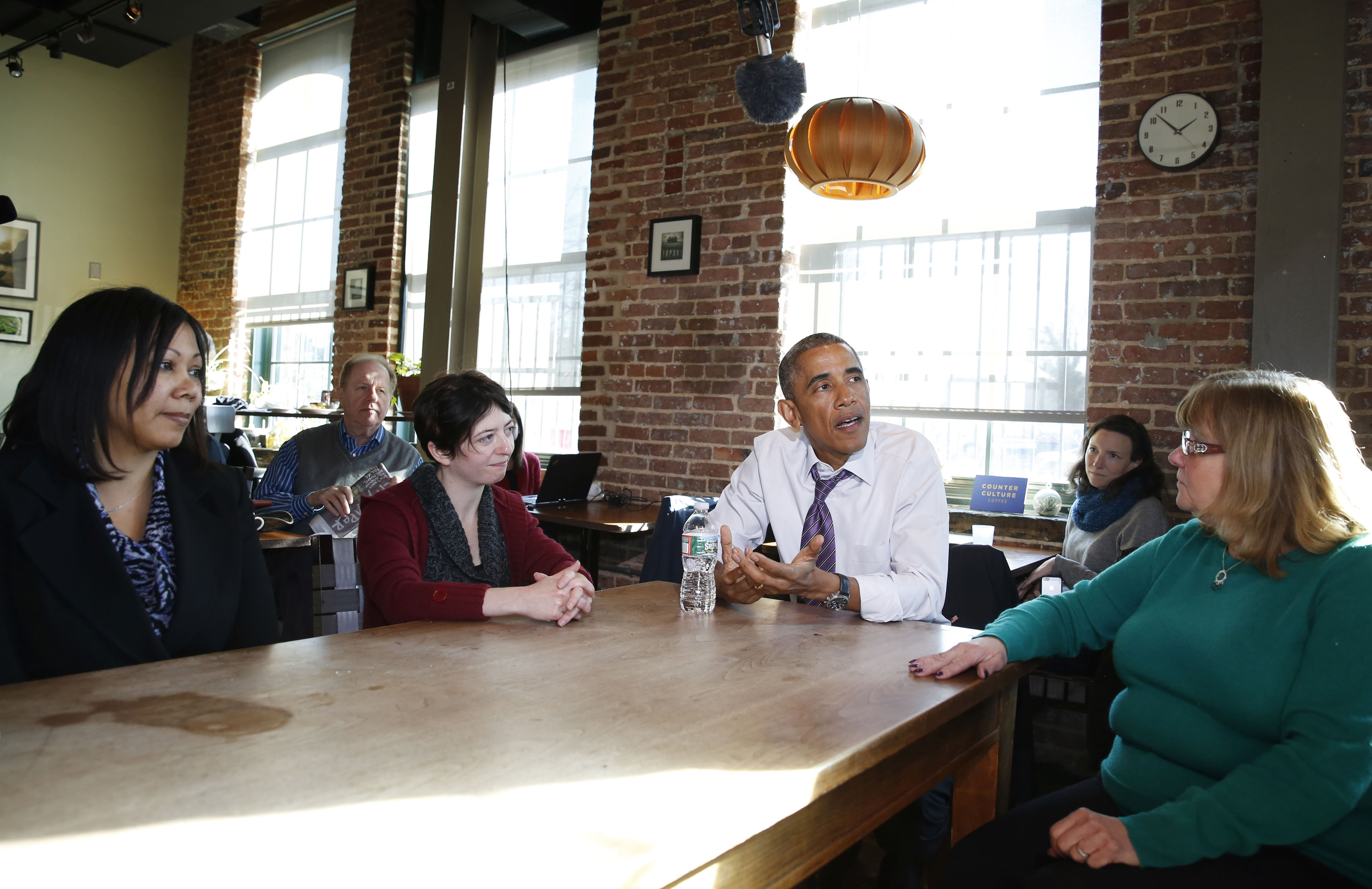 U.S. President Barack Obama speaks about legislation to offer paid sick leave for Americans while at Charmington's Cafe in Baltimore