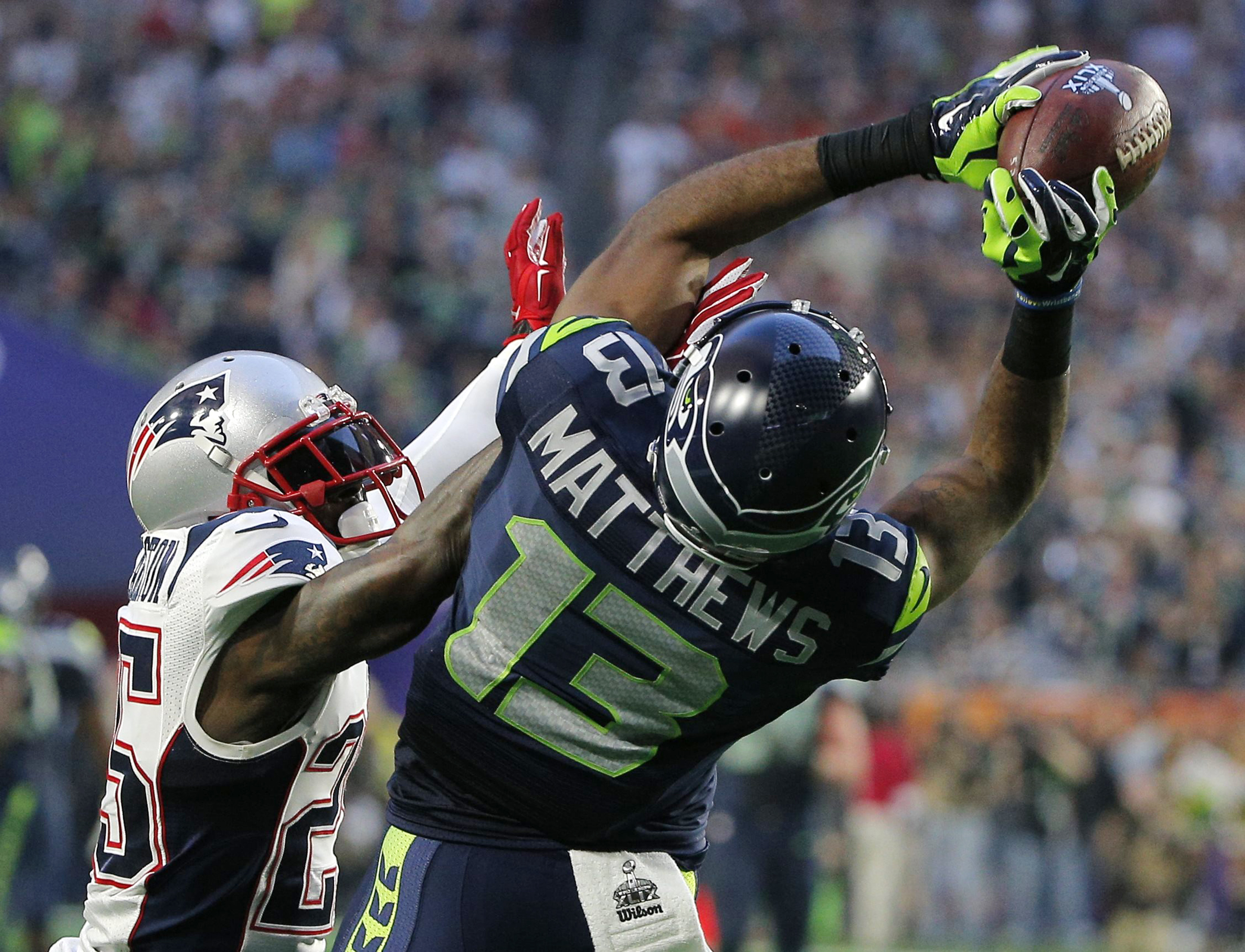 Seattle Seahawks wide receiver Matthews catches a pass against New England Patriots cornerback Arrington in the second quarter during the NFL Super Bowl XLIX football game in Glendale
