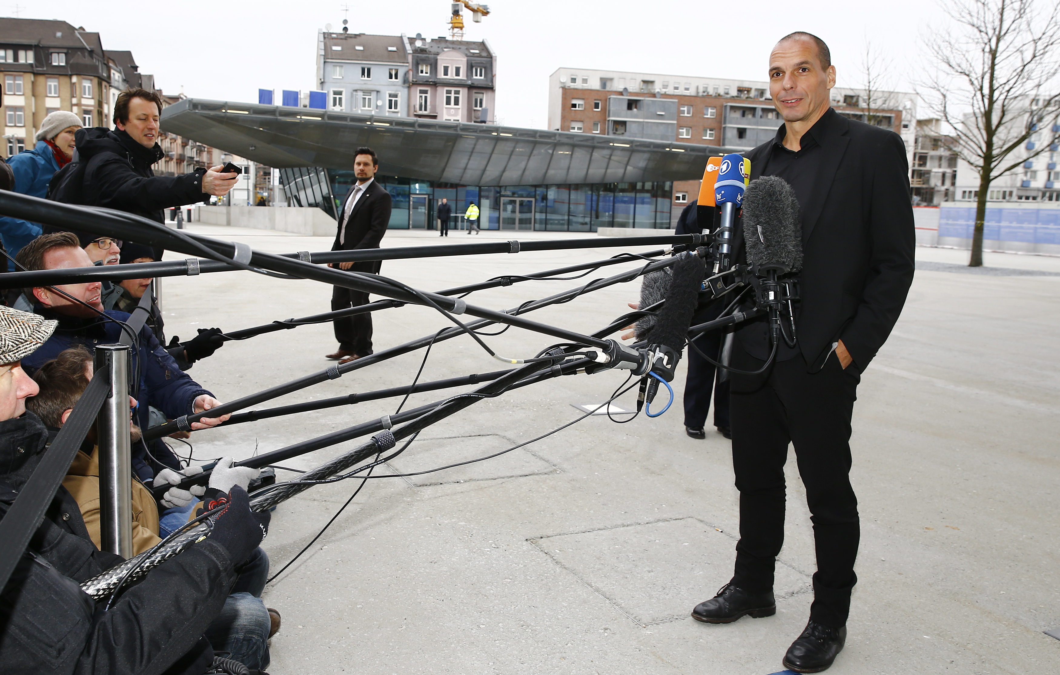 Greek Finance Minister Varoufakis speaks to media outside European Central Bank in Frankfurt