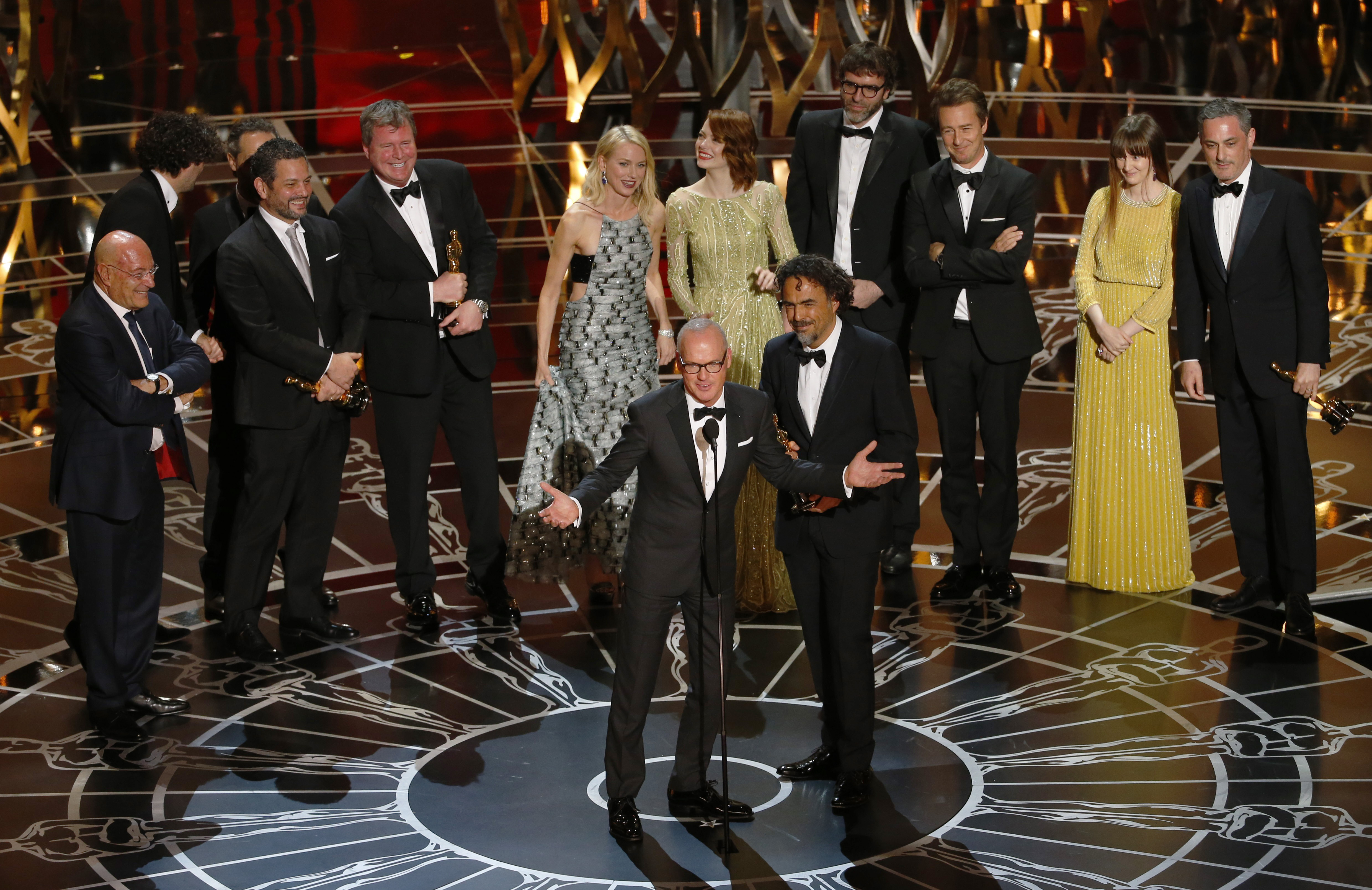 """Actor Keaton and director Inarritu accept the Oscar for best picture for his film """"Birdman""""during the 87th Academy Awards in Hollywood"""