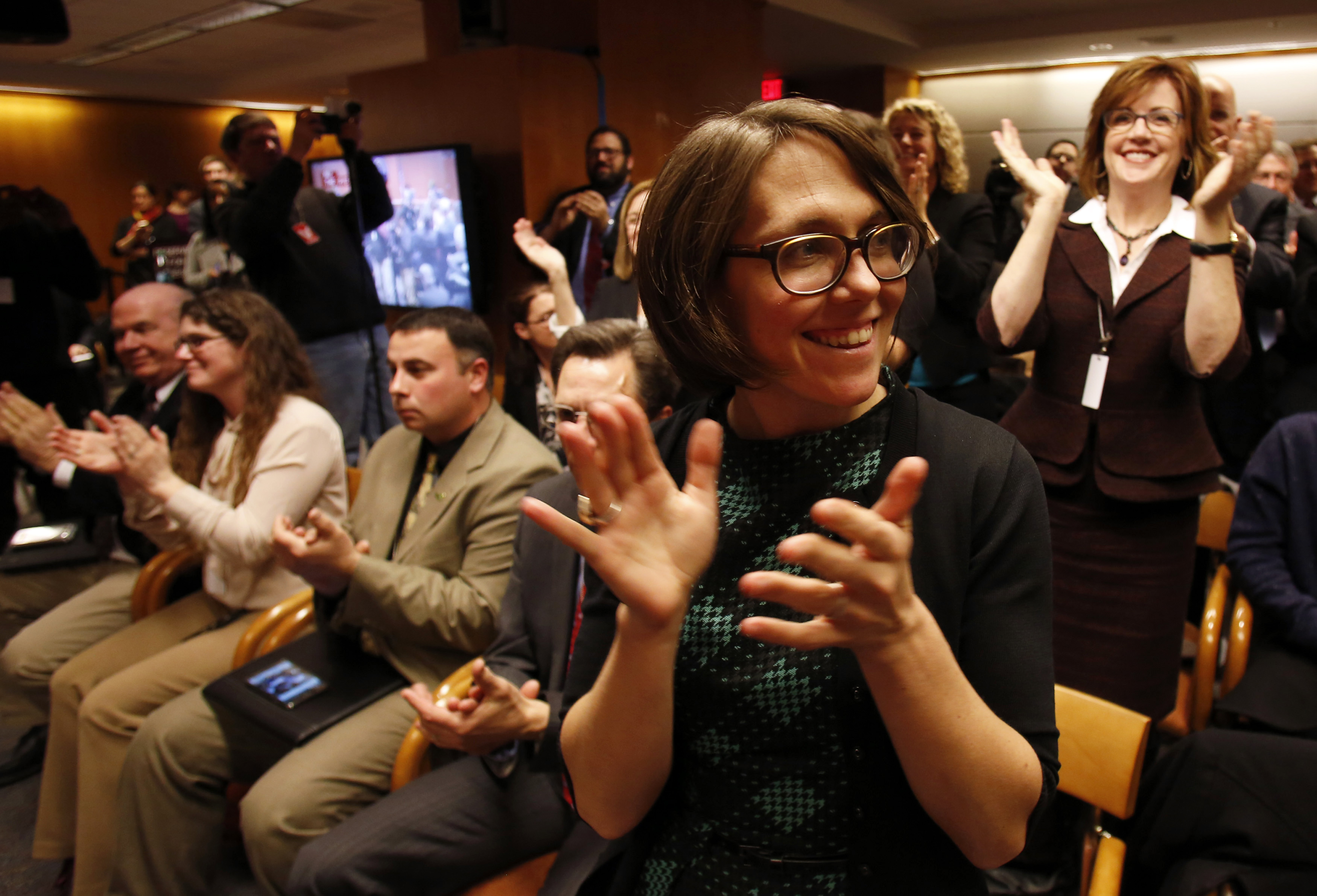Members of the audience react after Federal Communications Commission voting at Net Neutrality hearing in Washington