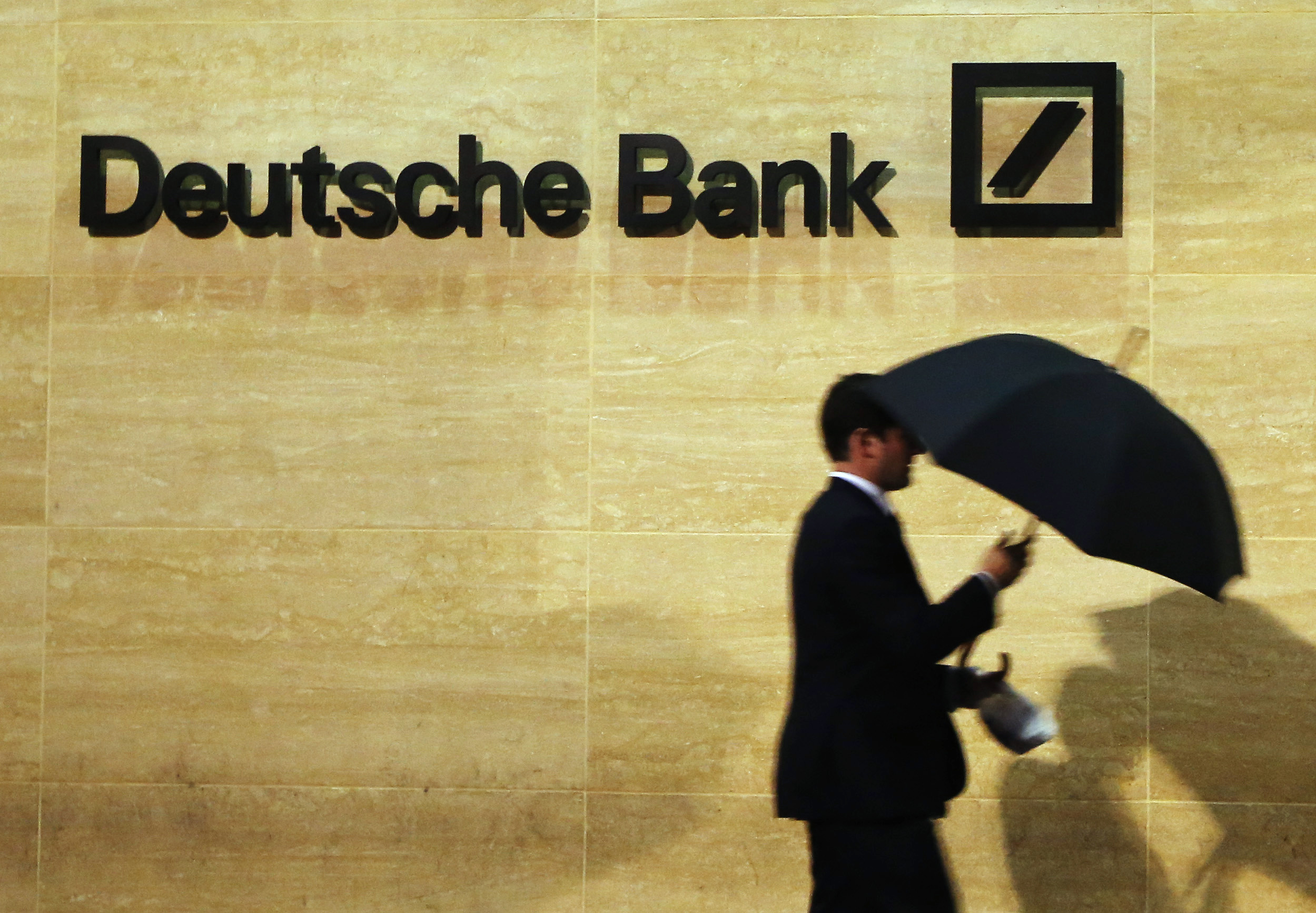 A man walks past Deutsche Bank offices in London