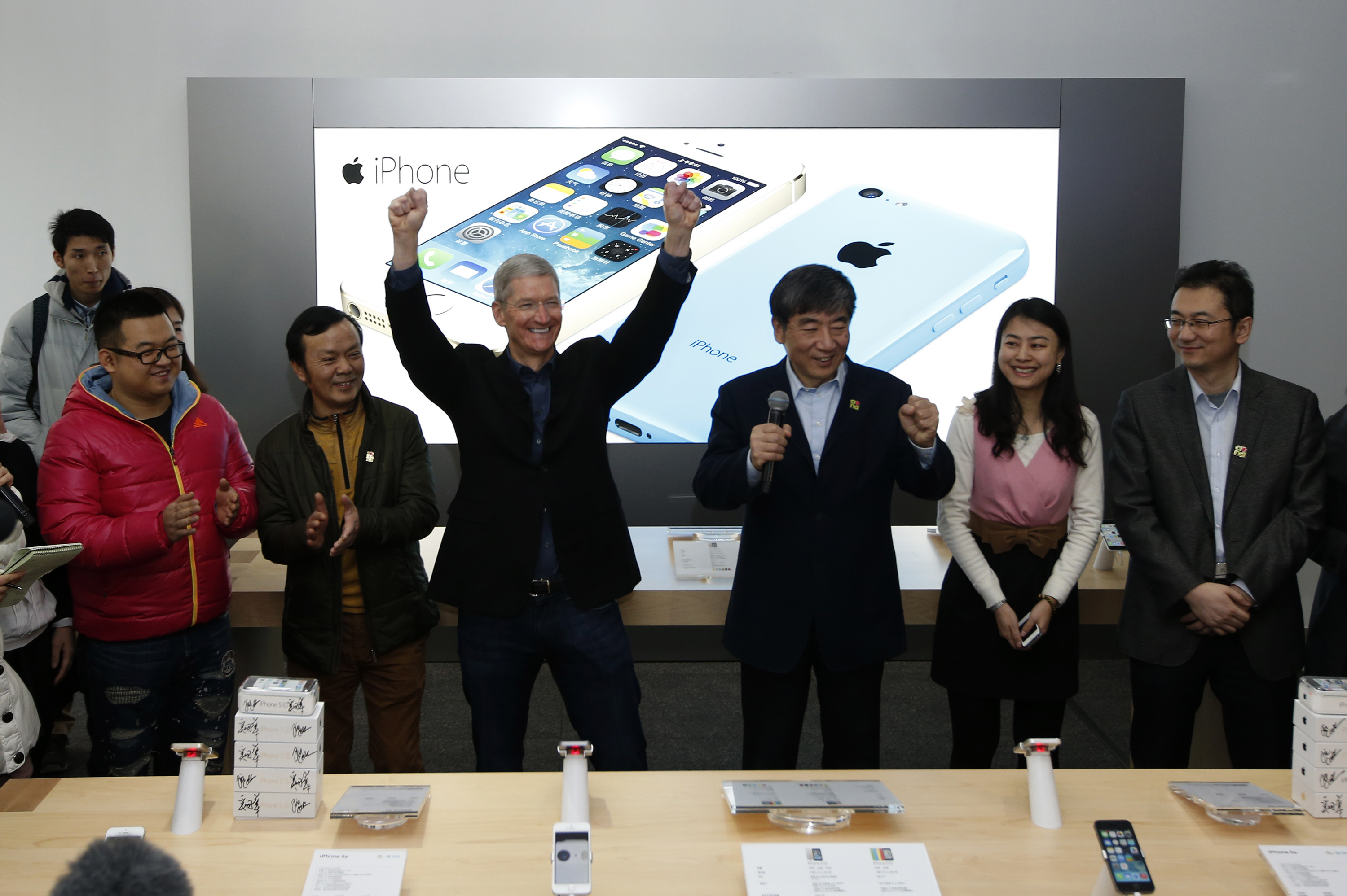 Apple Inc. CEO Tim Cook reacts at an event celebrating the launching of Apple's iPhone on China Mobile's network in Beijing