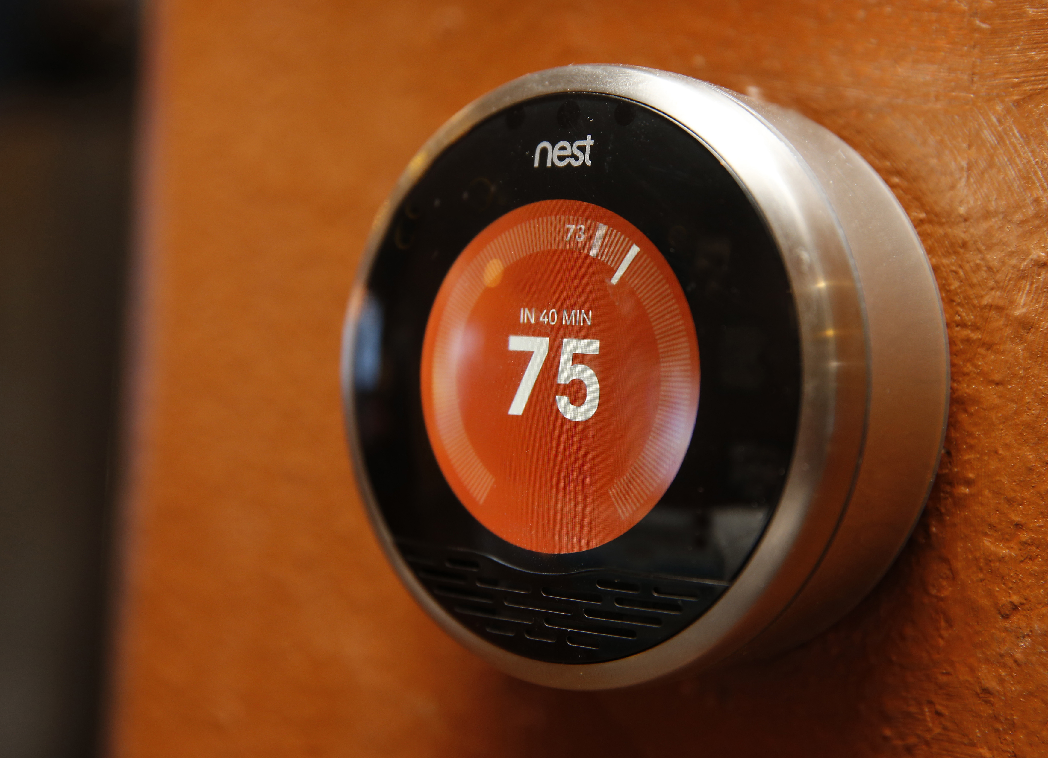 A Nest thermostat is installed in a home in Provo