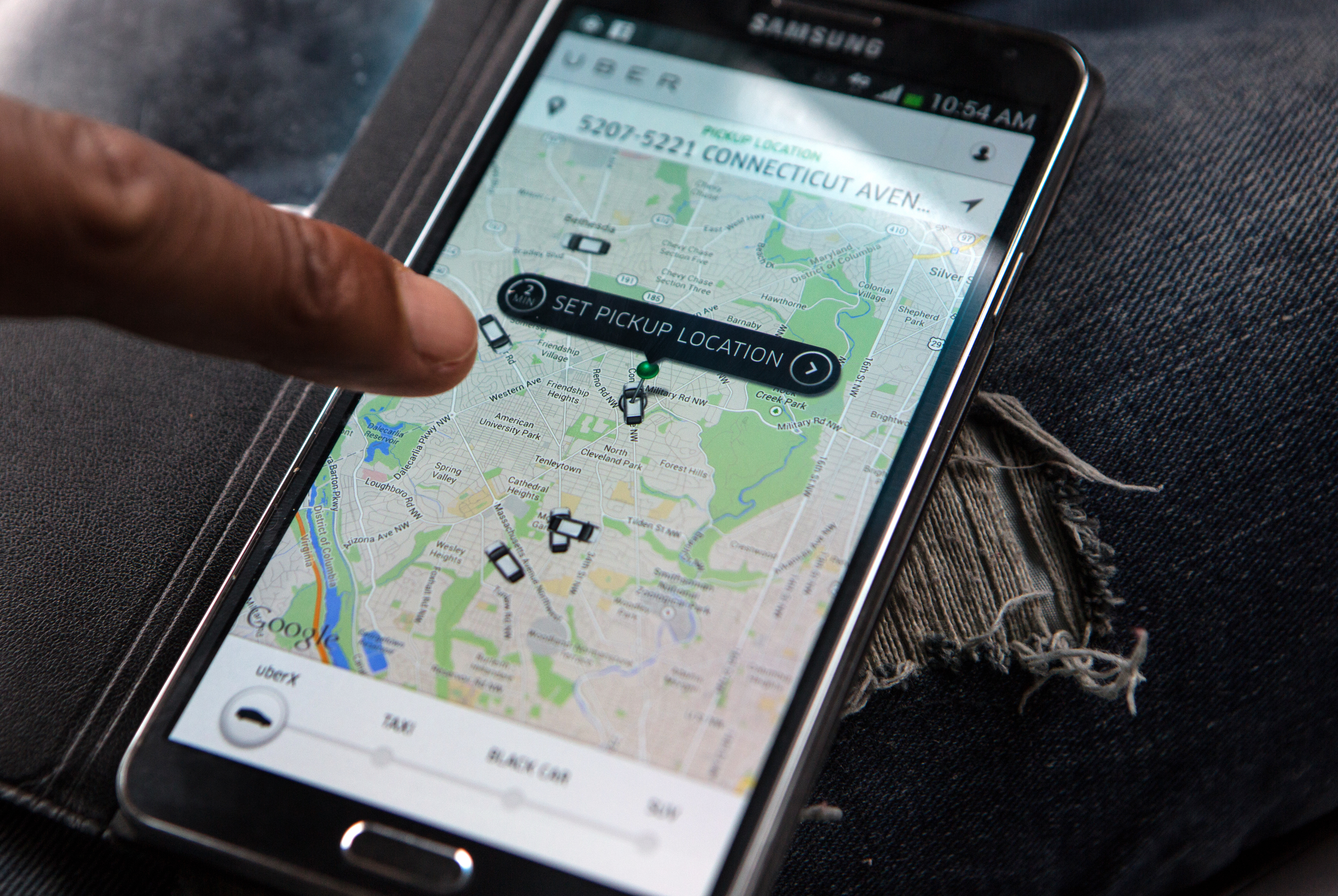 An UberX driver checks the app to see where other drivers are located.