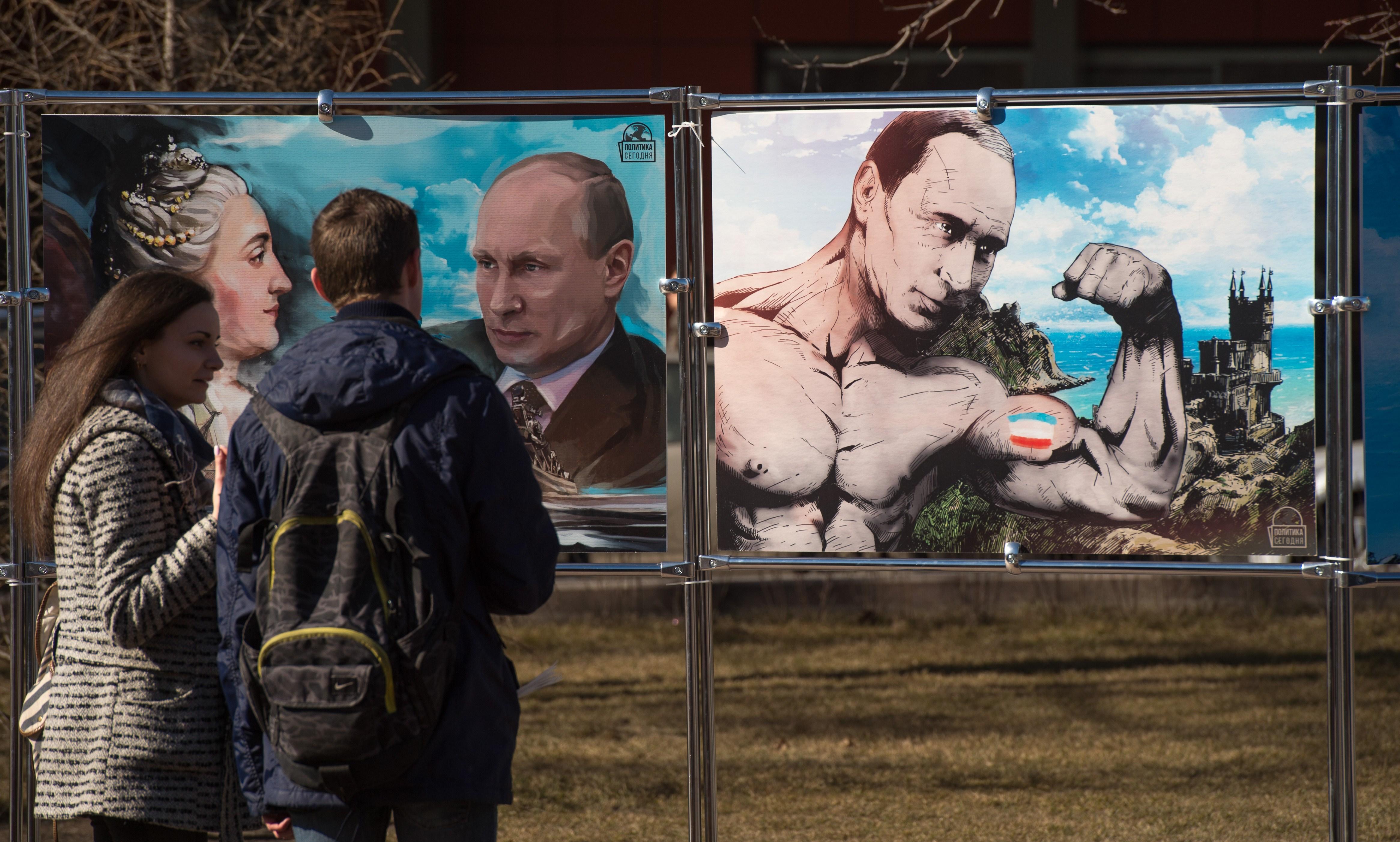 RUSSIA-UKRAINE-CRISIS-CRIMEA-ANNIVERSARY-CARTOONS-EXHIBITION