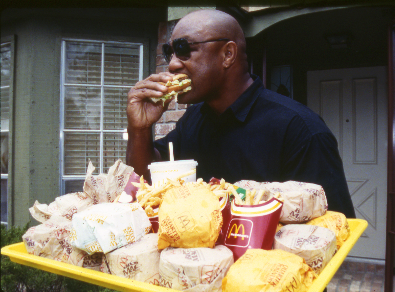 USA George Foreman Eating Hamburgers