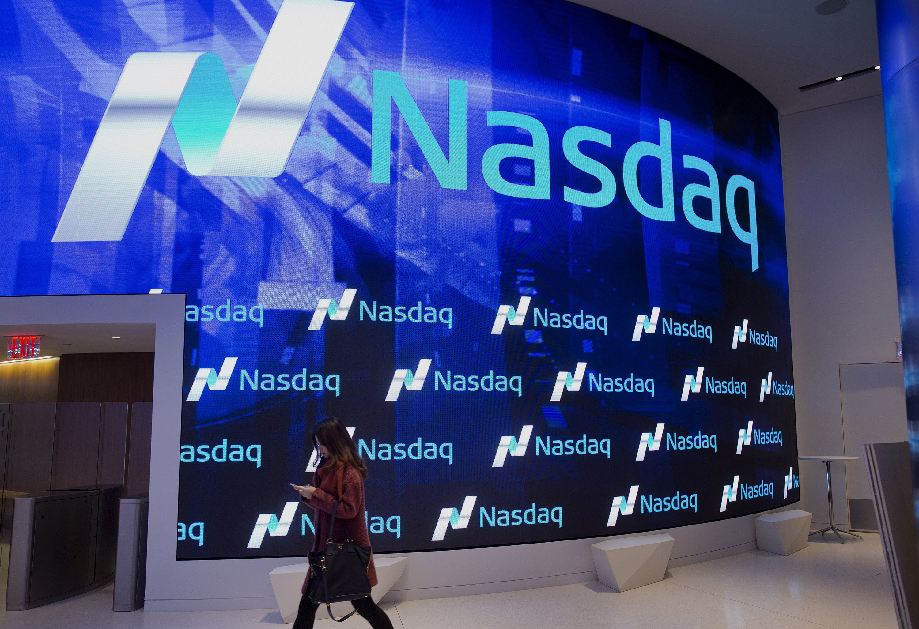 A visitor walks through the new lobby at the Nasdaq stock exchange in Times Square in New York, NY, Friday, December 19, 2014.Photograph: Victor J. Blue