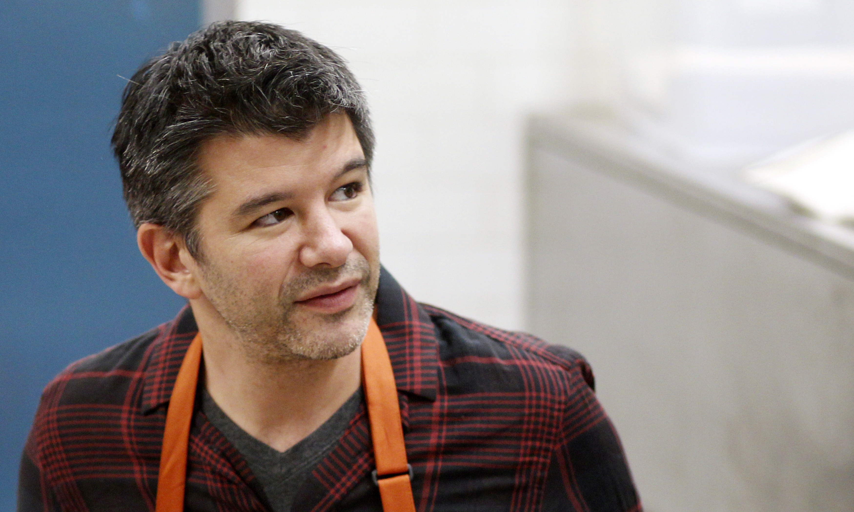 Uber CEO Travis Kalanick works with fourth graders during Cooking Matters, a nutrition class taught by 18 Reasons, a local partner of Share our Strength at Glen Park Elementary School in San Francisco