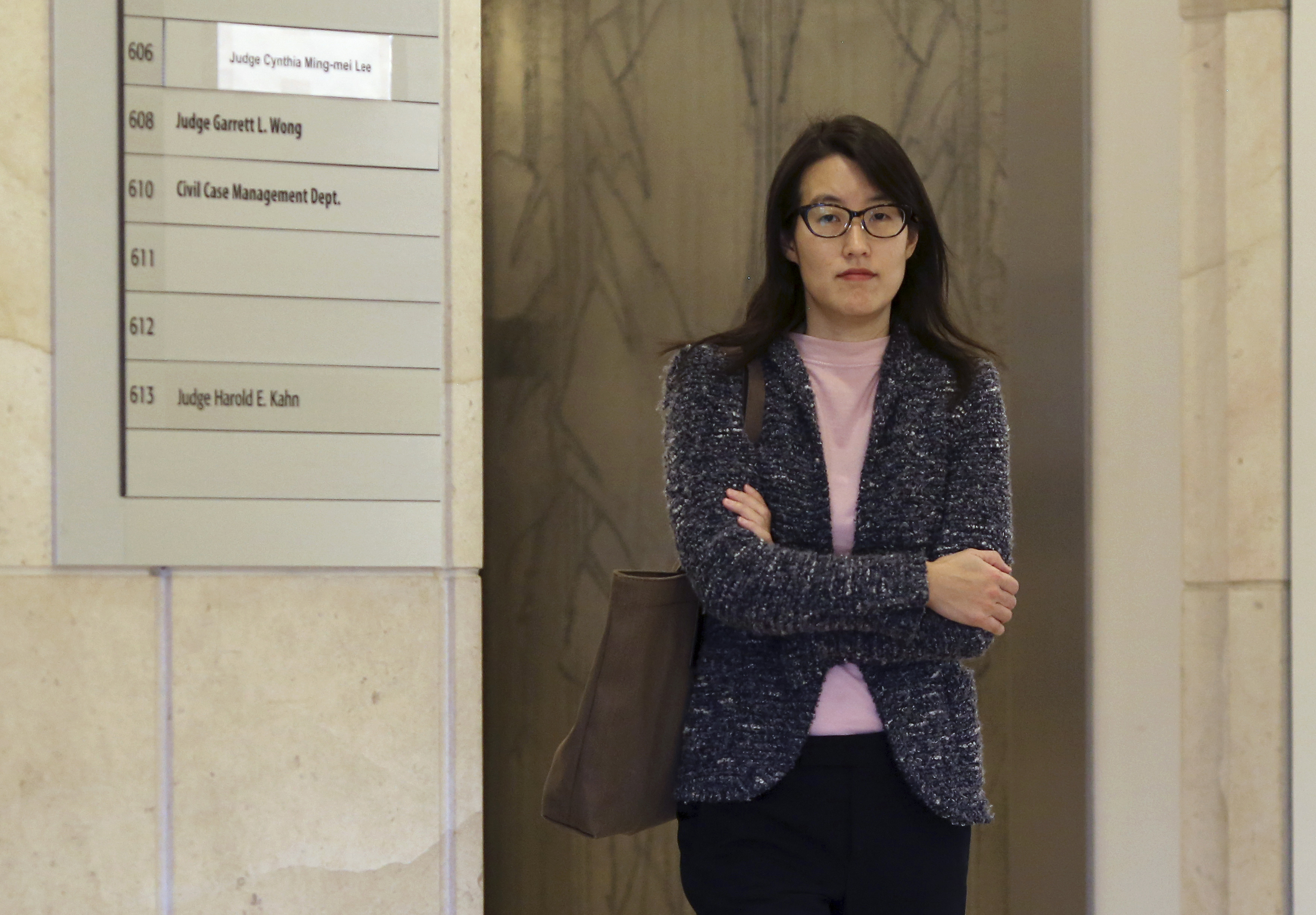 Ellen Pao walks to a courtroom in San Francisco Superior Court in San Francisco