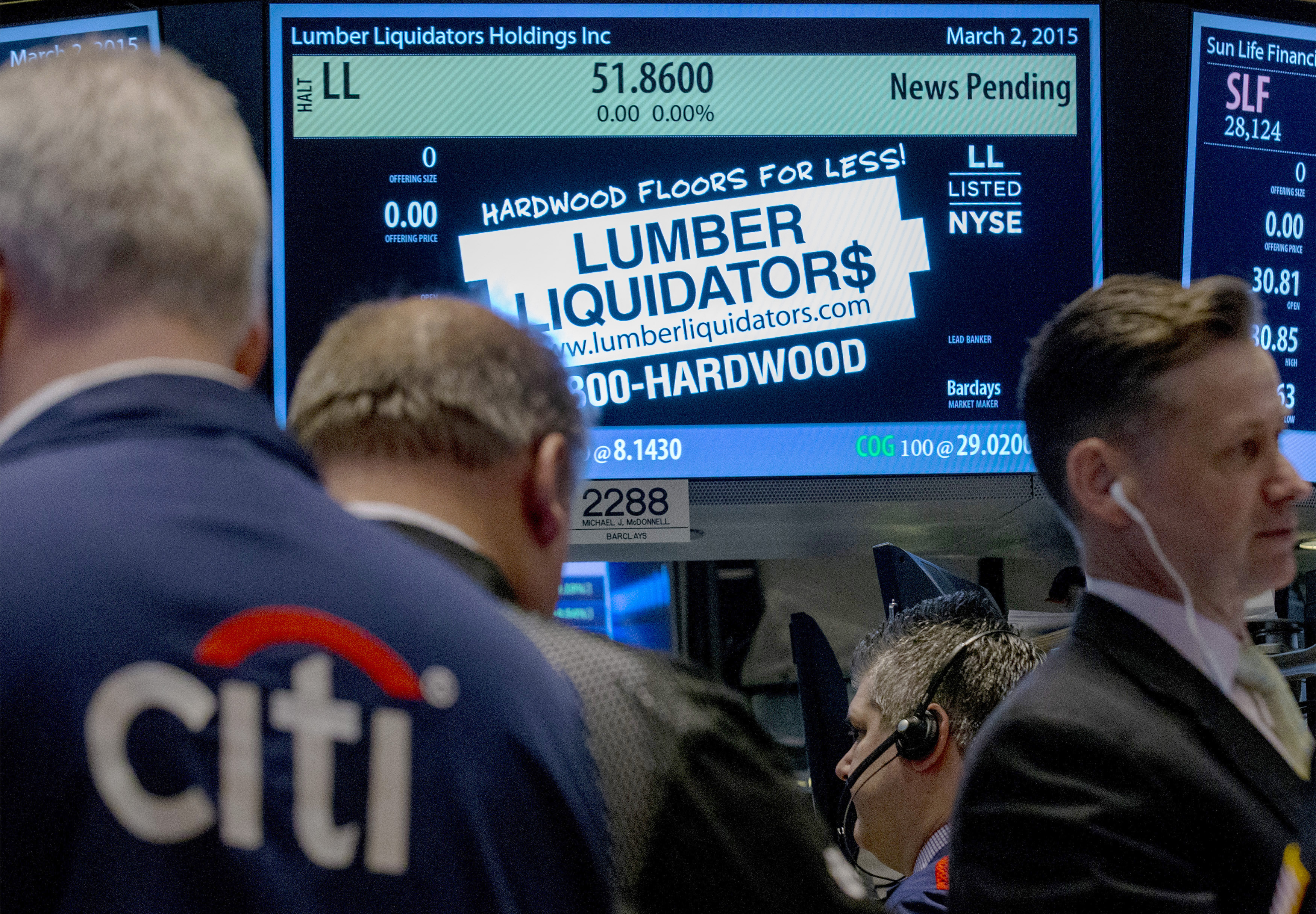 Traders wait for shares of Lumber Liquidators to begin trading on the floor of the New York Stock Exchange