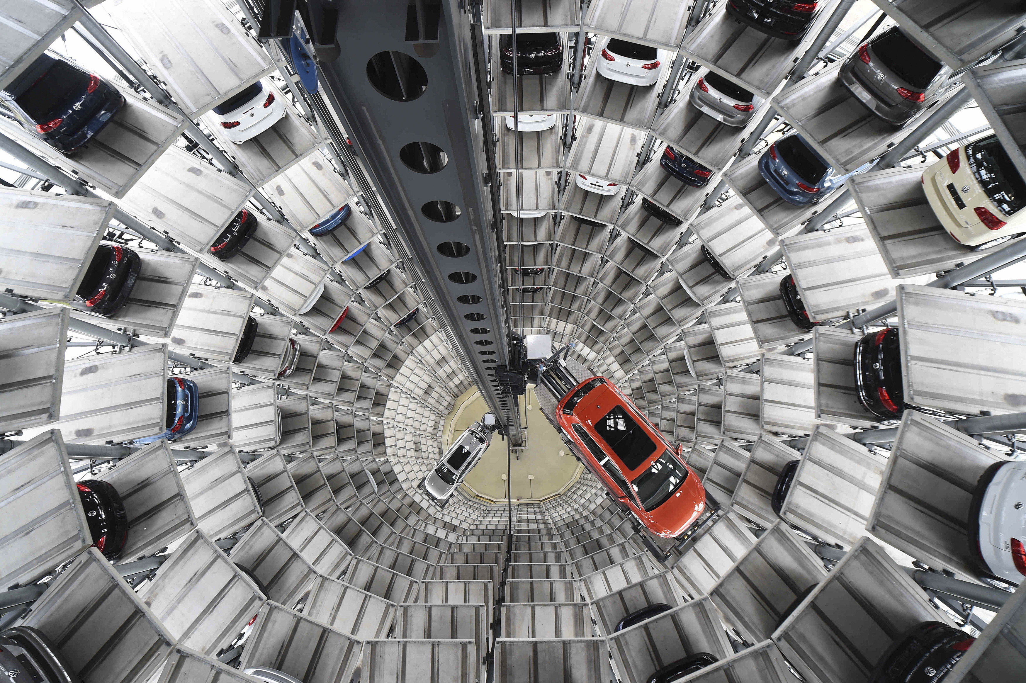 A VW Golf VII car and a VW Passat are loaded  in a delivery tower at the plant of German carmaker Volkswagen in Wolfsburg