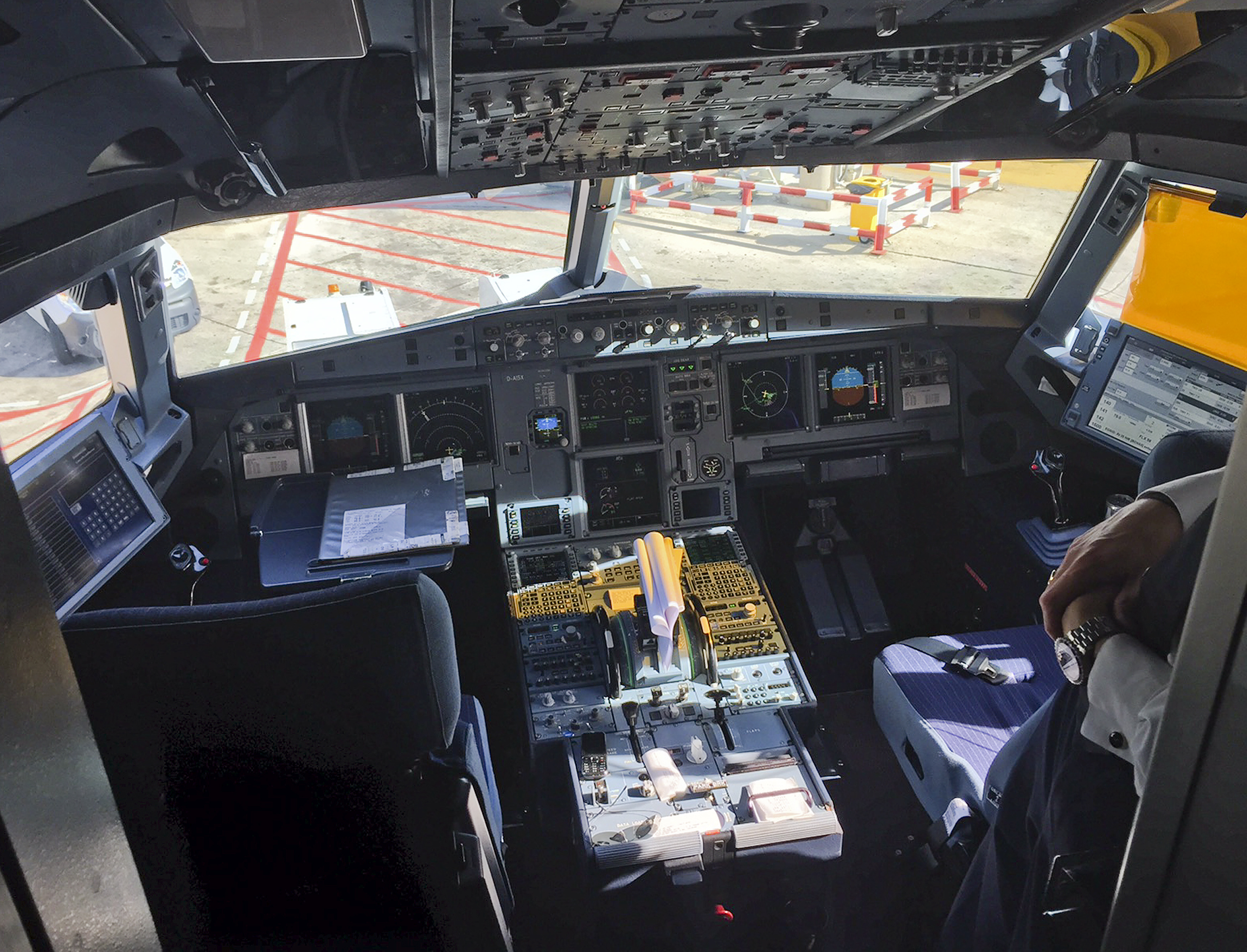 A pilot stands inside the cockpit of Airbus A321 during boarding in Barcelona