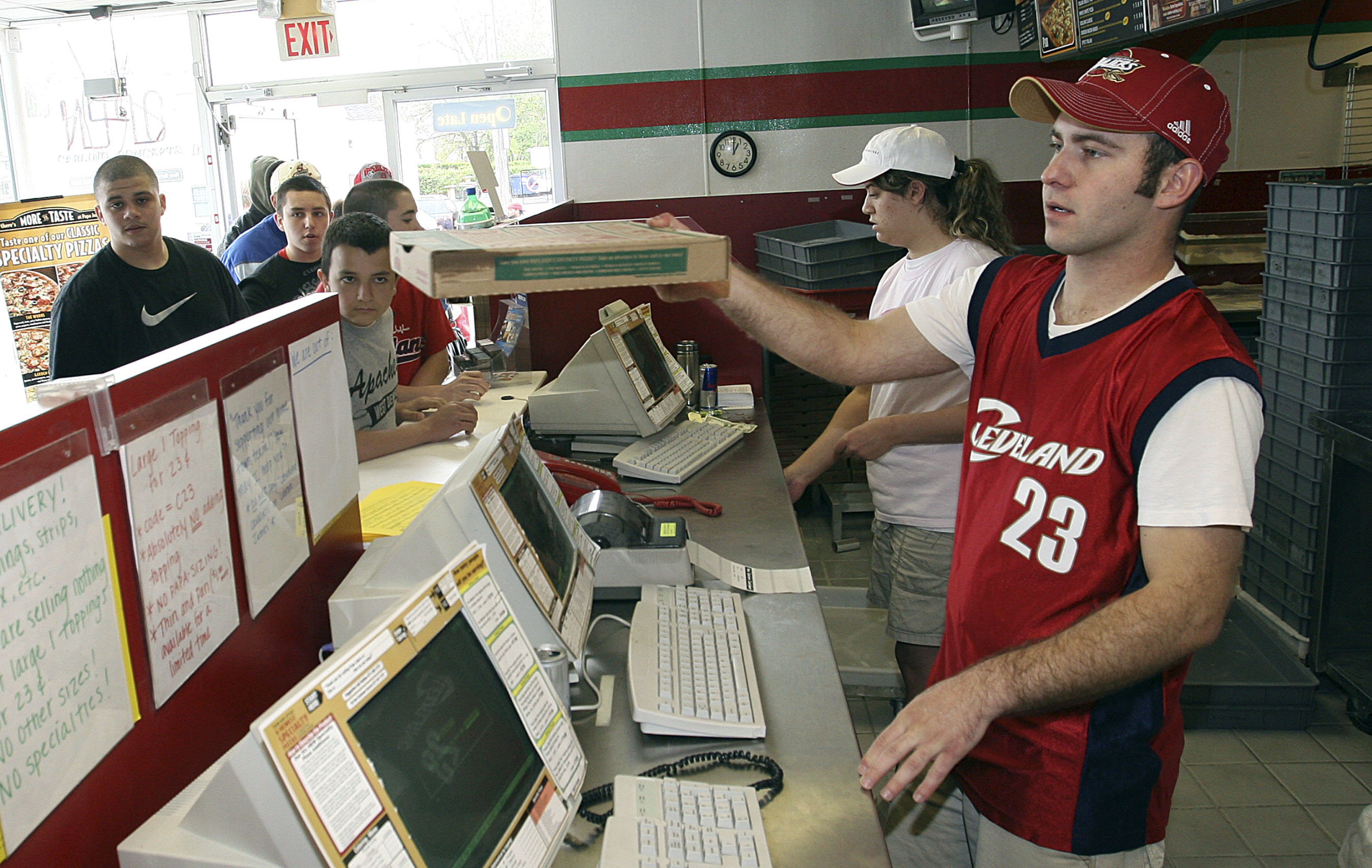 Papa Johns worker hands out pizzas in response to Washington D.C. Papa Johns promotion in which Cavaliers James was shown on shirts as cry baby in Lakewood