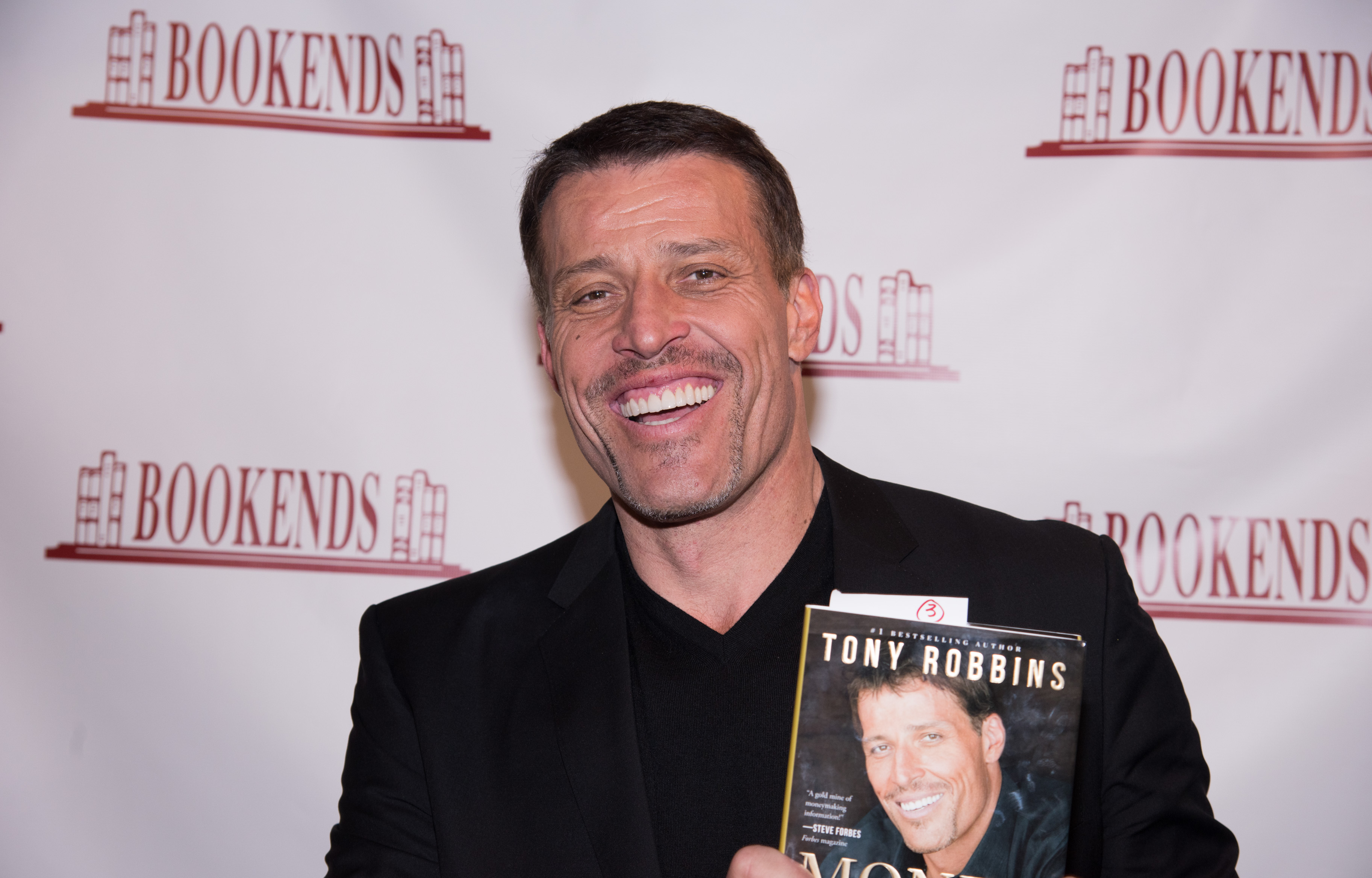 """Tony Robbins Signs Copies Of His Book """"Money: Master Of The Game"""""""