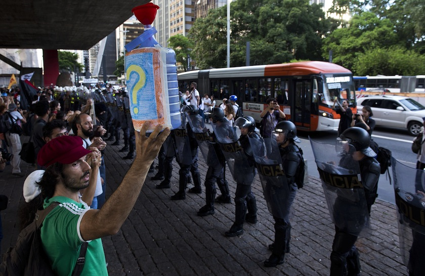 Demonstrators protest the lack of water in front of a police barricade in Sao Paulo, Brazil