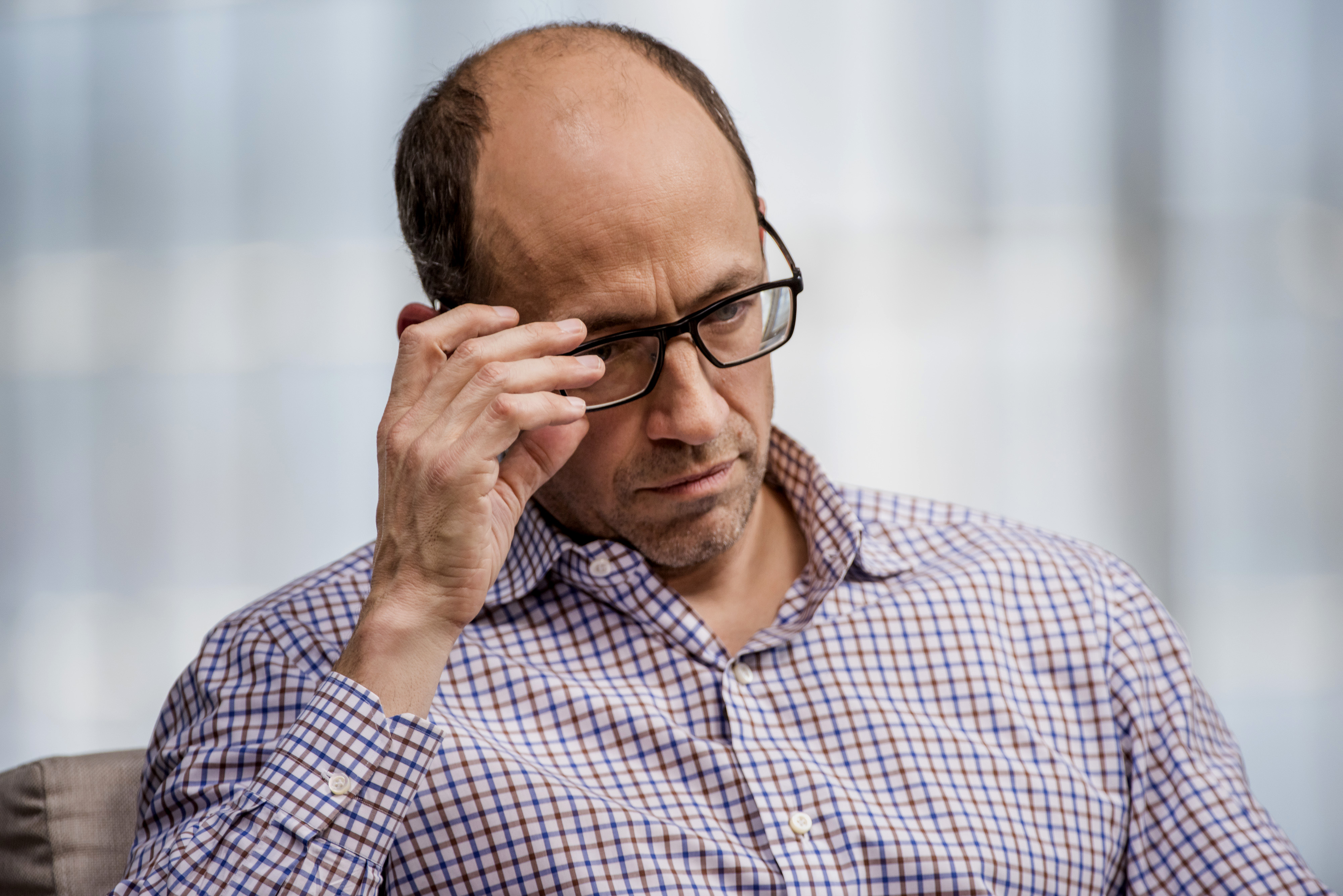 """Richard """"Dick"""" Costolo, chief executive officer of Twitter Inc., pauses during a Bloomberg Television interview in San Francisco, California, U.S., on Wednesday, March 18, 2015. Twitter Inc. provides an online social networking and micorblogging service offering users activity, read and post tweets worldwide. Photographer: David Paul Morris/Bloomberg *** Local Caption *** Dick Costolo"""