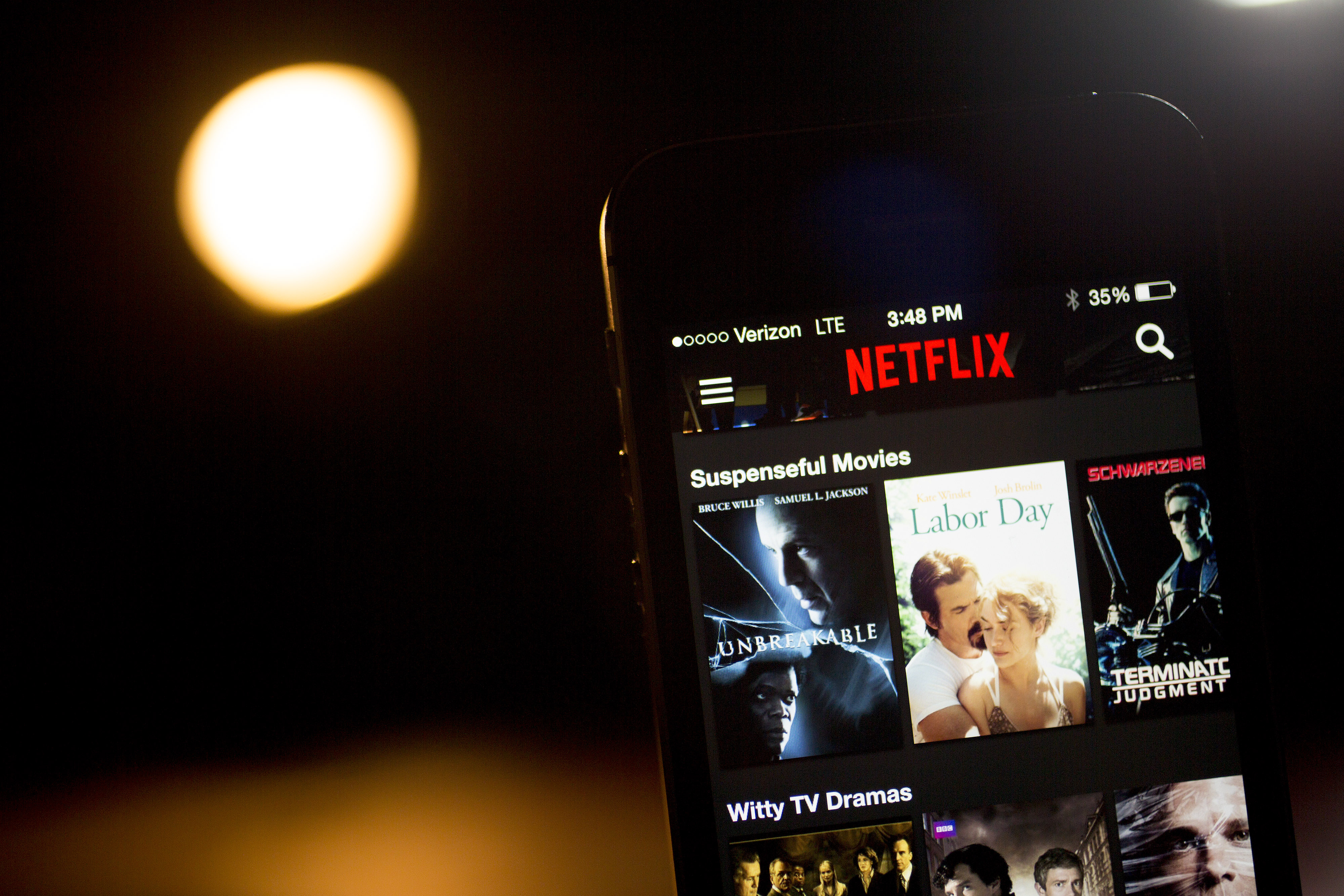 Caption:The Netflix Inc. application is displayed on an Apple Inc. iPhone 5s for a photograph in Washington, D.C., U.S., on Tuesday, April 14, 2015. Netflix Inc., the largest online subscription video service, is expected to release earnings figures on April 15. Photographer: Andrew Harrer/Bloomberg via Getty Images