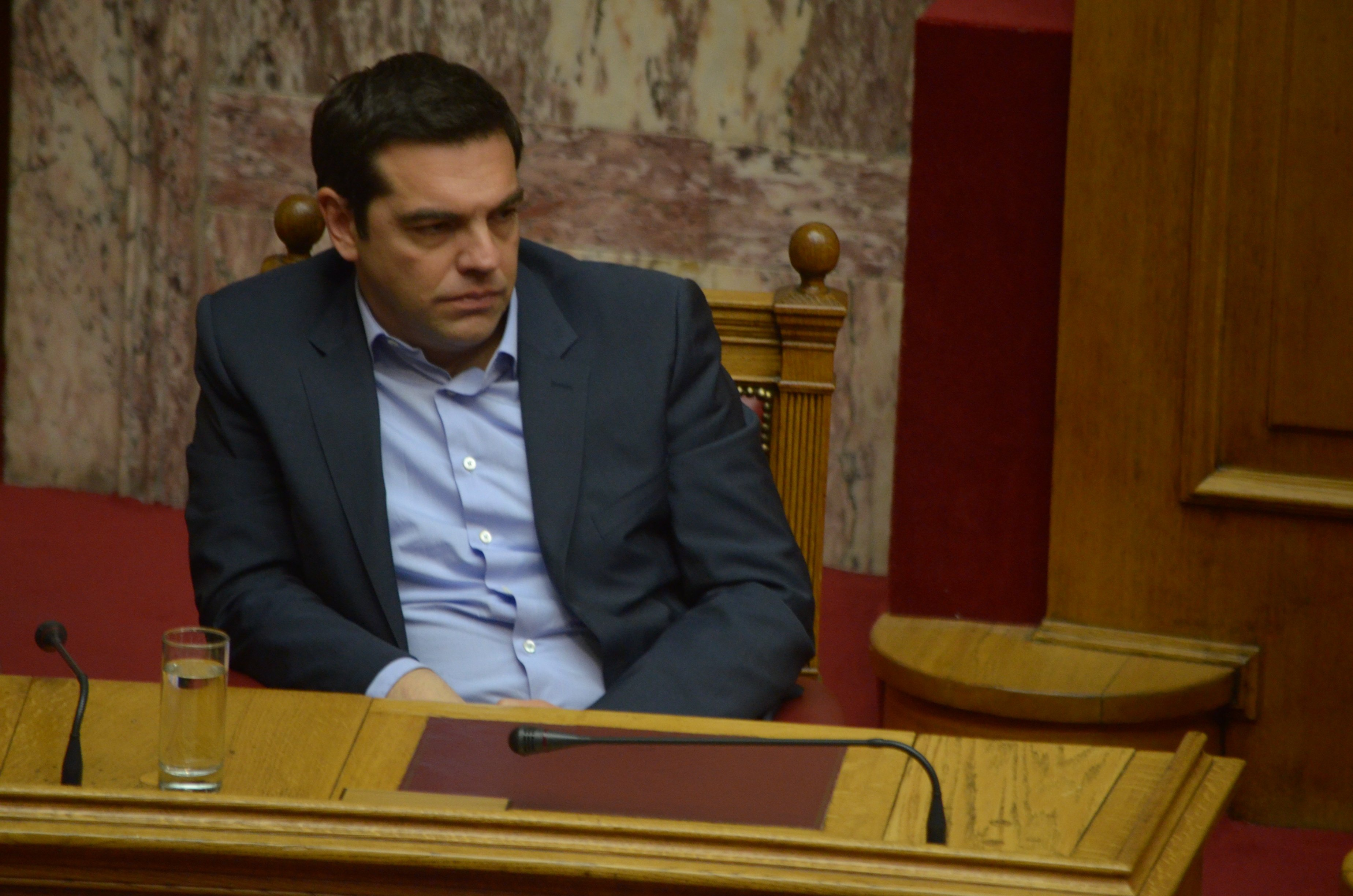 Prime Minister of Greece Aexis Tsipras sits in the Greek
