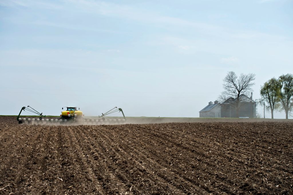 A Deere & Co John Deere 8130 tractor pulls a 24-row planter