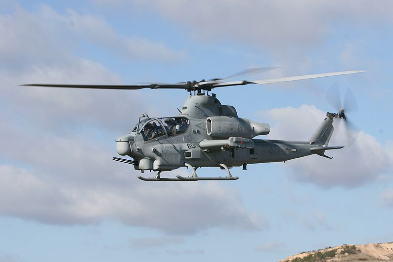 U.S. Marine Corps pilots maneuver an AH-1Z Viper attack helicopter.