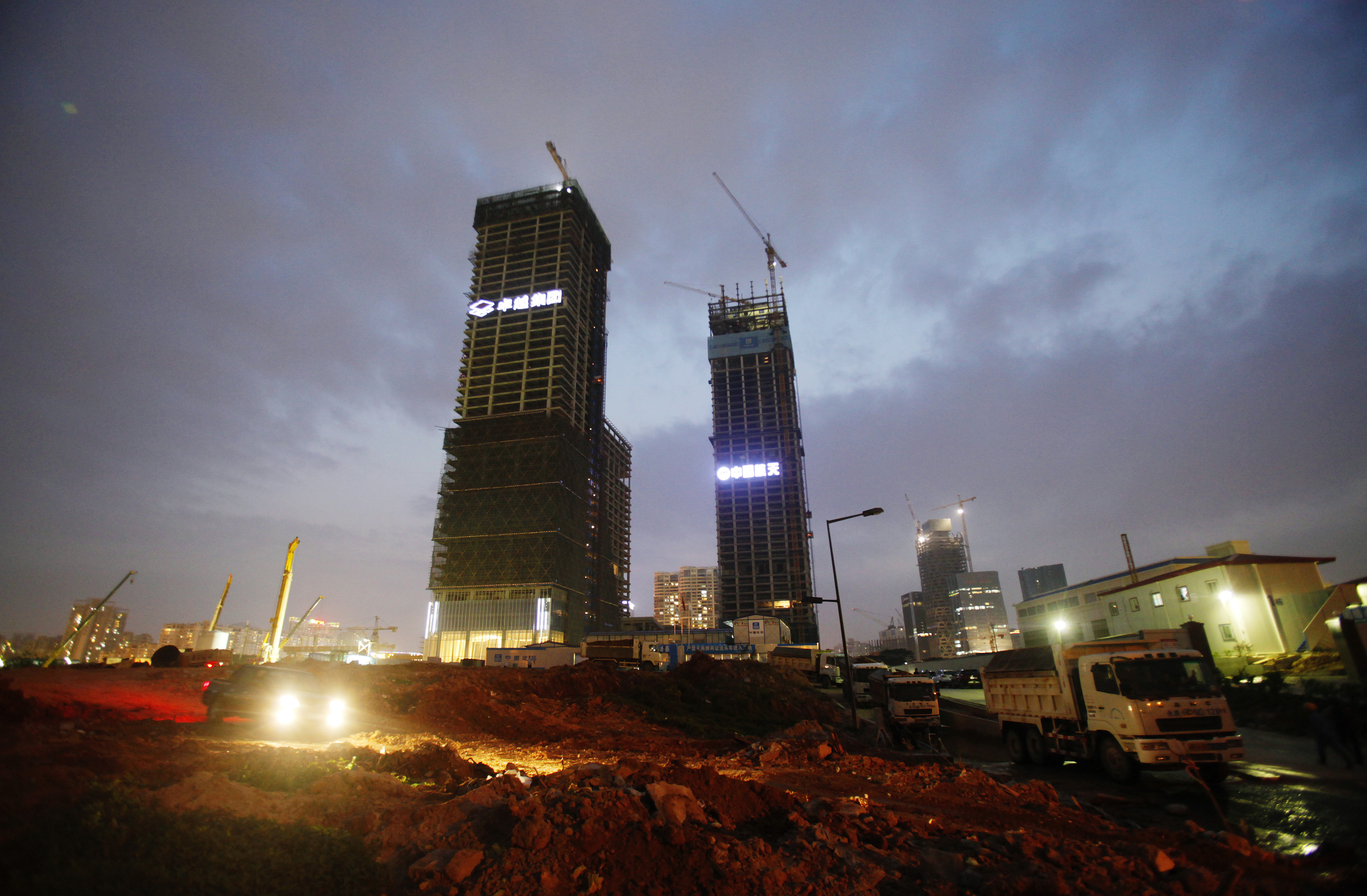 Buildings in construction are seen at Excellence Real Estate Group's construction site in Qianhai district of Shenzhen