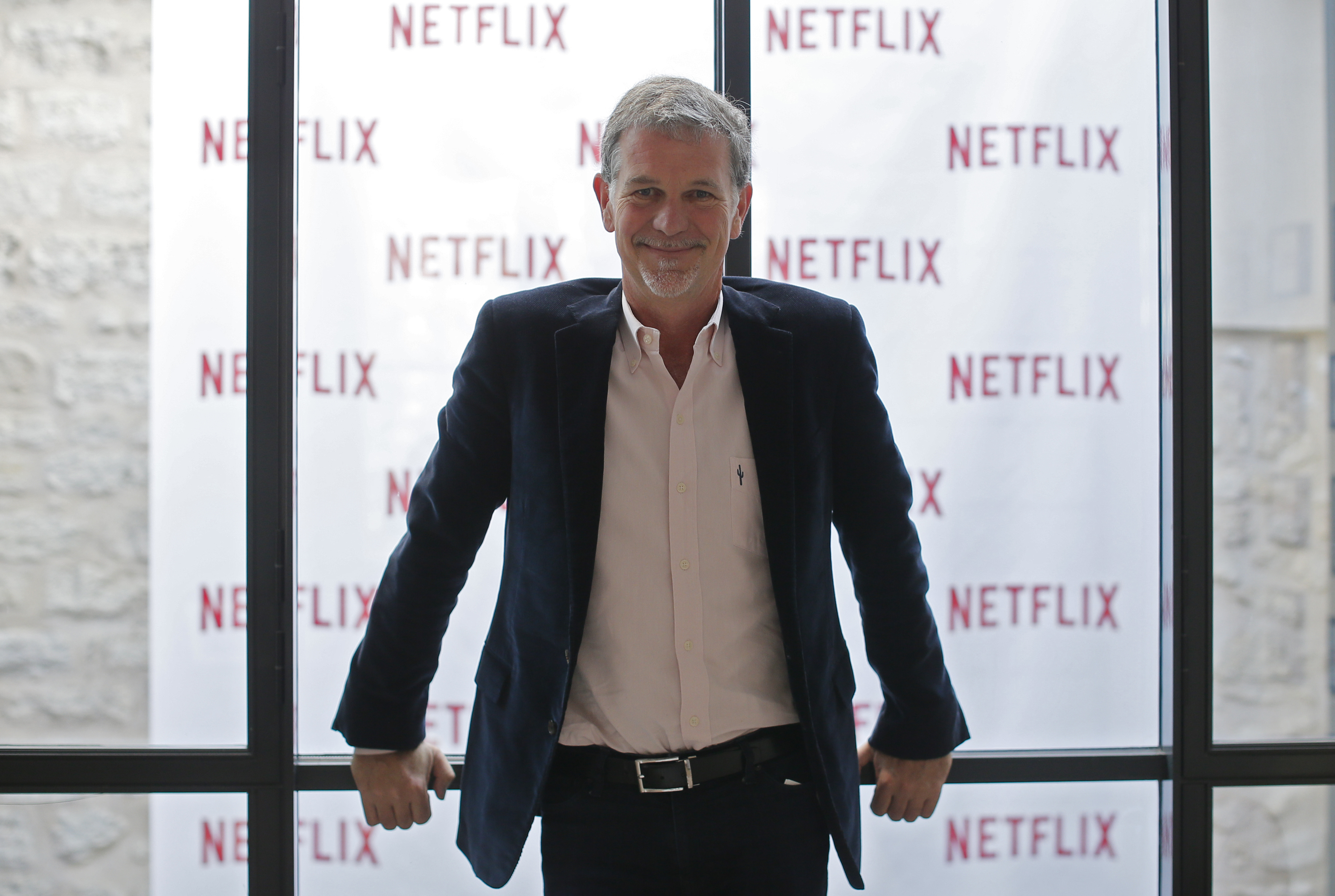 Reed Hastings, founder and CEO of Netflix, poses during an interview with Reuters in Paris