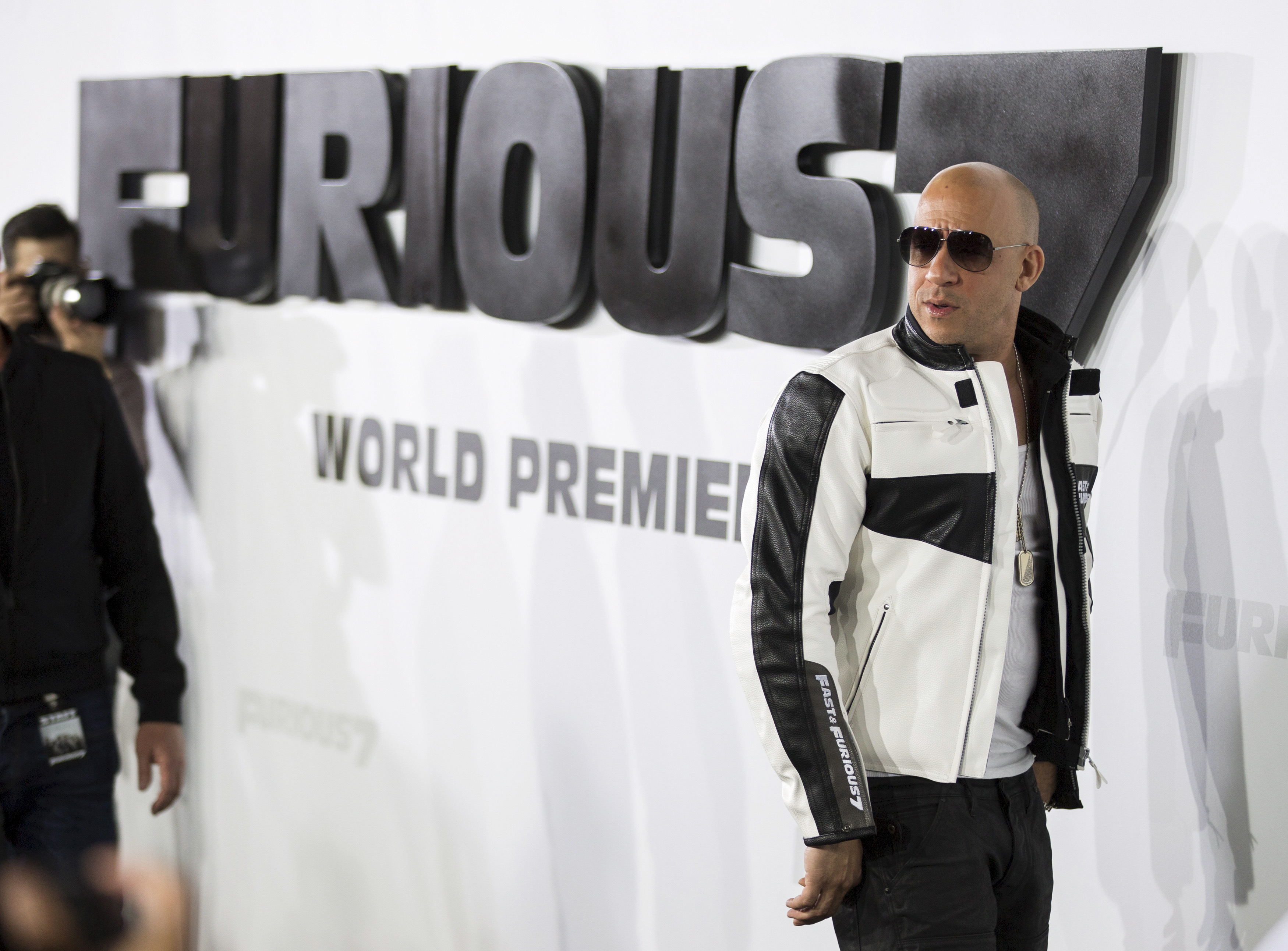 """Cast member Diesel poses at fans at the premiere of """"Furious 7"""" at the TCL Chinese theatre in Hollywood"""