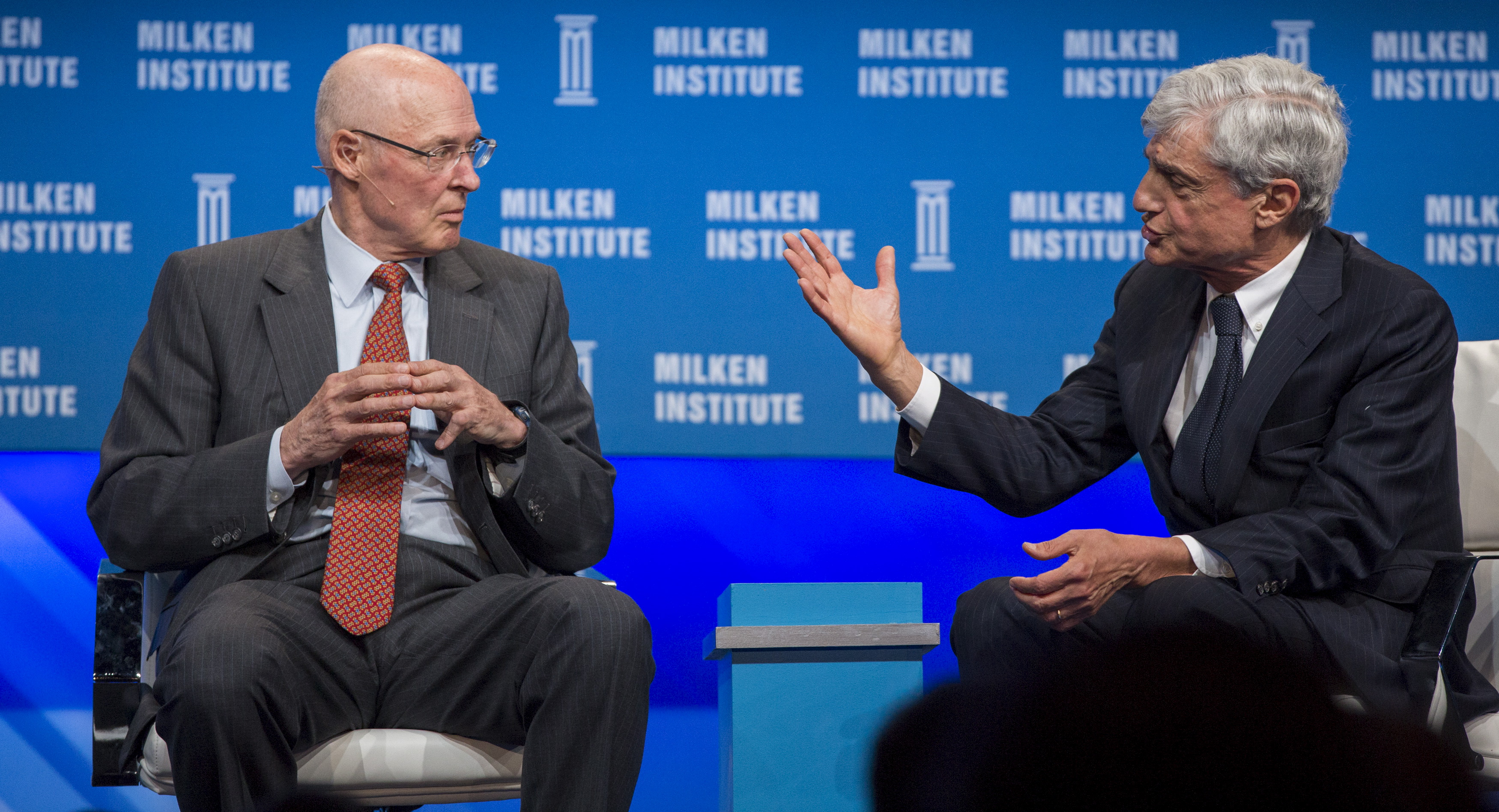 """Former U.S. Treasury Secretaries Paulson and Rubin attend a panel discussion titled """"The Global Economy"""" at the Milken Institute Global Conference in Beverly Hills"""