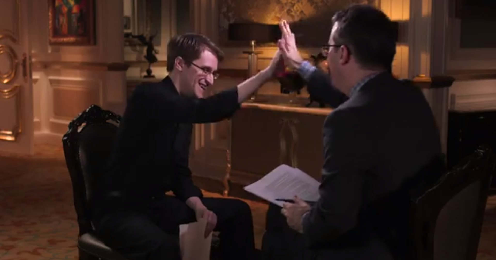 """John Oliver solicits a high five from Edward Snowden after making a sexual joke about """"bulk collection."""""""