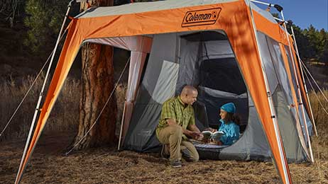 Father daughter camping scene featuring our Coleman brand.