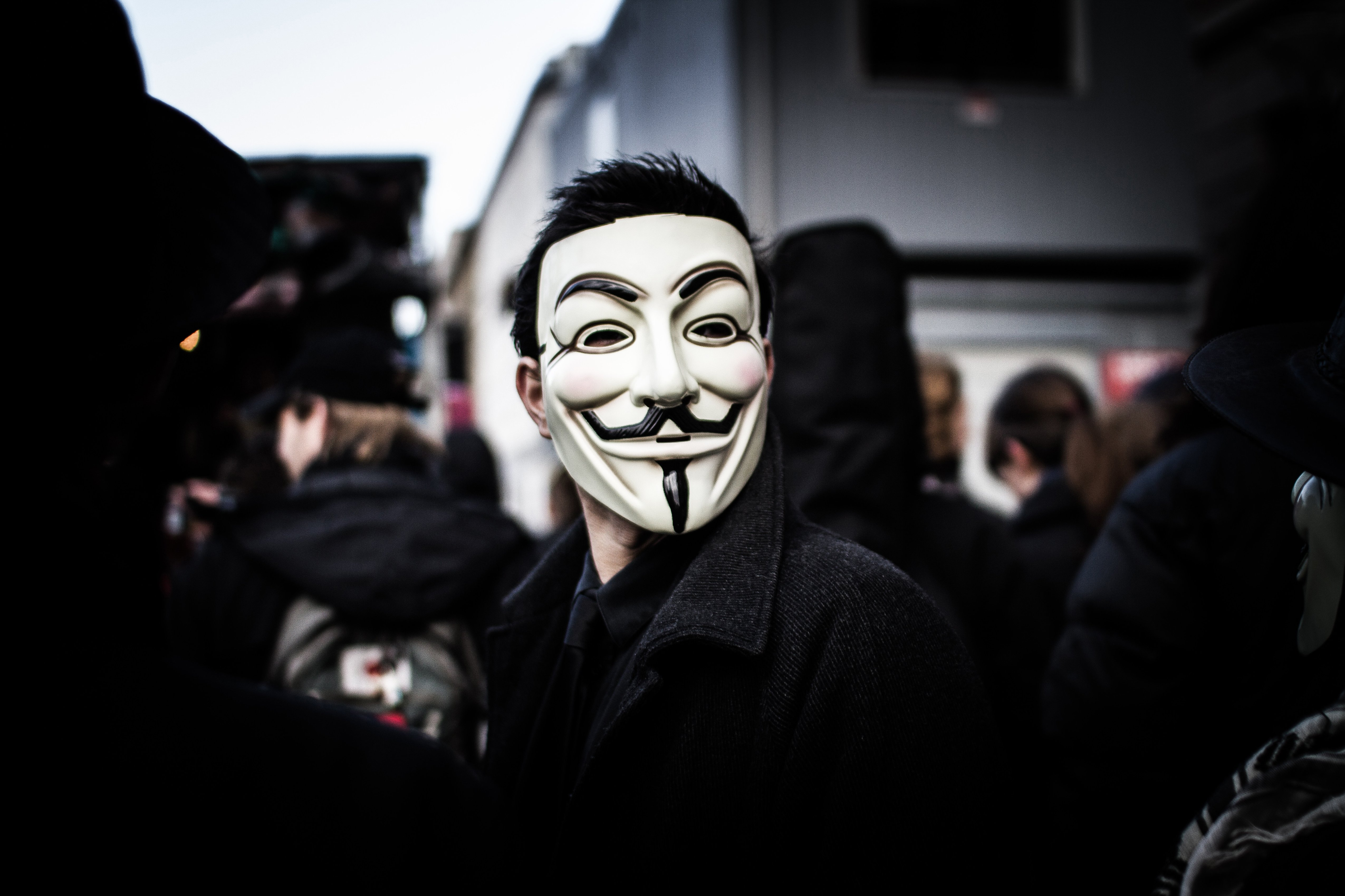 Person wears a Guy Fawkes mask which today is a trademark and symbol for the online hacktivist group Anonymous. 2012.