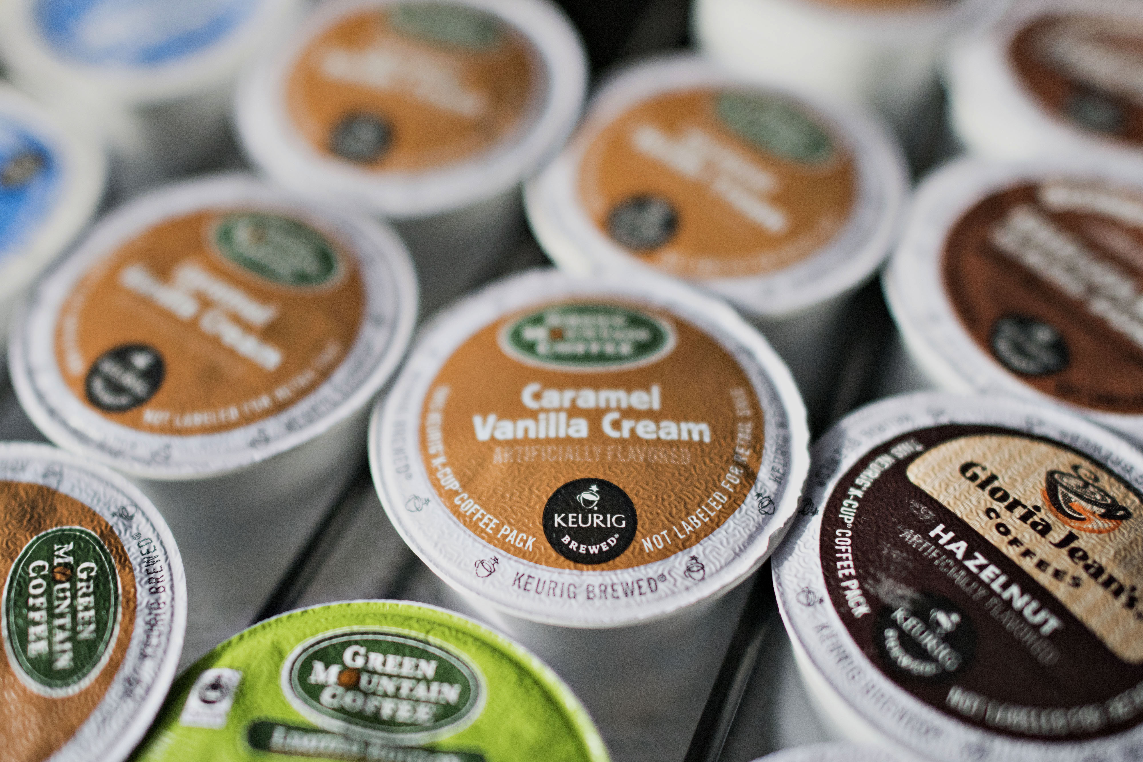 "Keurig Green Mountain Inc. ""K-cup"" coffee pods sit near a coffee machine in a salon in Princeton, Illinois, U.S., on Tuesday, Feb. 3, 2015. Keurig Green Mountain Inc., is scheduled to report quarterly earnings on Feb. 4. Photographer:  Daniel Acker/Bloomberg"