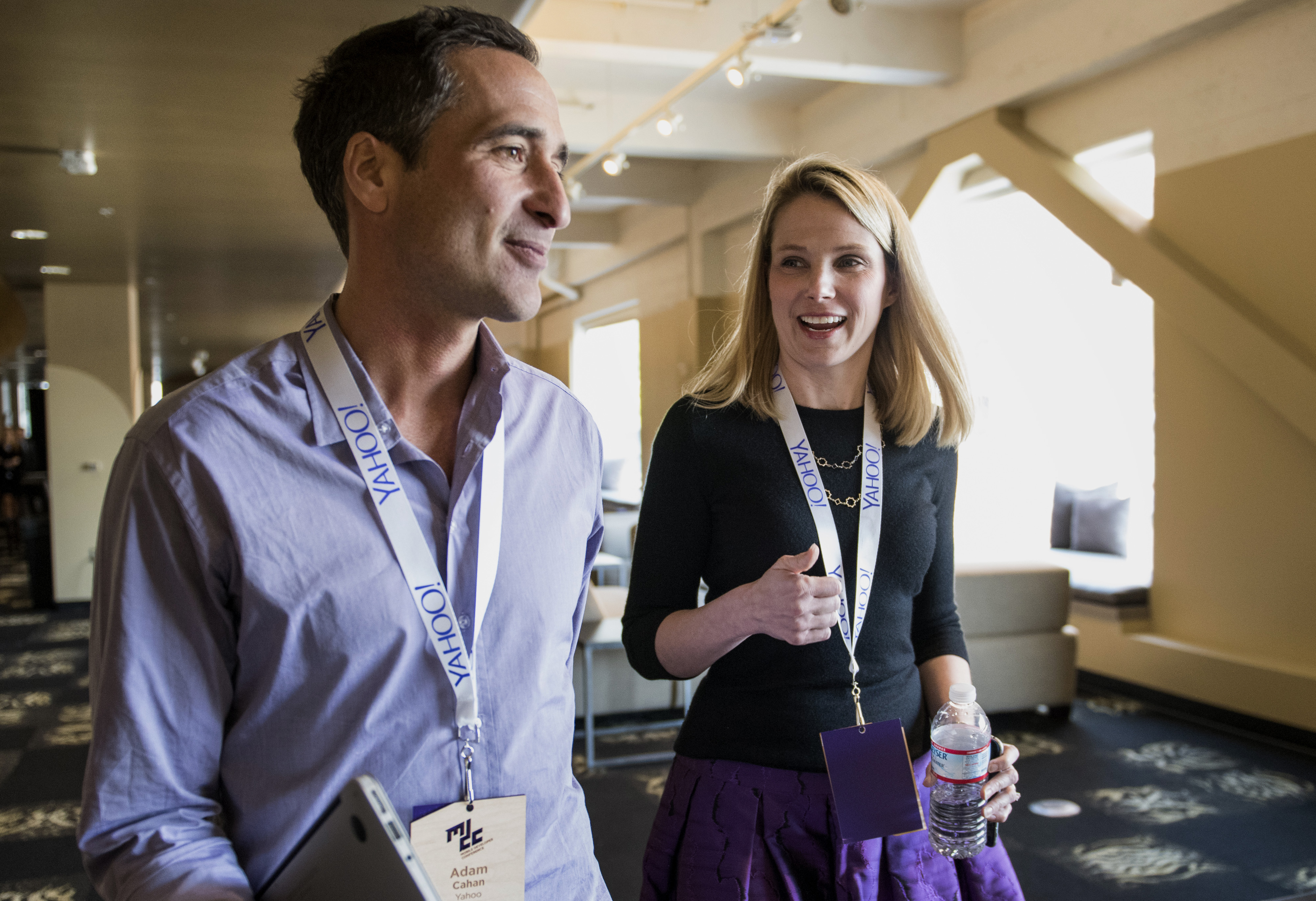 Marissa Mayer, president and chief executive officer at Yahoo! Inc., right, speaks with Adam Cahan, senior vice president of Mobile and Emerging Products, at Yahoo! as they leave a press conference at the Yahoo! Inc. Mobile Developer Conference in San Francisco, California, U.S., on Thursday, Feb. 19, 2015. The conference will unveil a new suite of services designed to help mobile developers better understand users, while improving, growing and monetizing their apps. Photographer: David Paul Morris/Bloomberg *** Local Caption *** Marissa Mayer;Adam Cahan