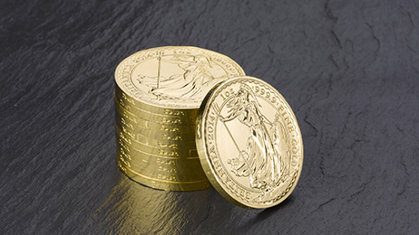 """One of A-Mark's exclusive products. In this case it is the """"Year of the Horse Gold Britannia"""". You will notice the horse images in the rim of the coins."""