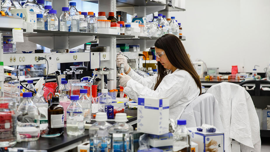 A Biogen researcher in their Boston lab working on Alzheimer drug currently in trials.