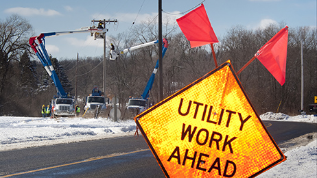 Consumers Energy employees work on the company's electric lines.