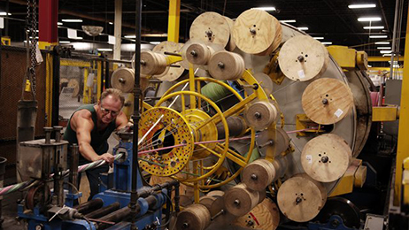 A General Cable associate works on a cabling machine in our Lincoln, Rhode Island plant.
