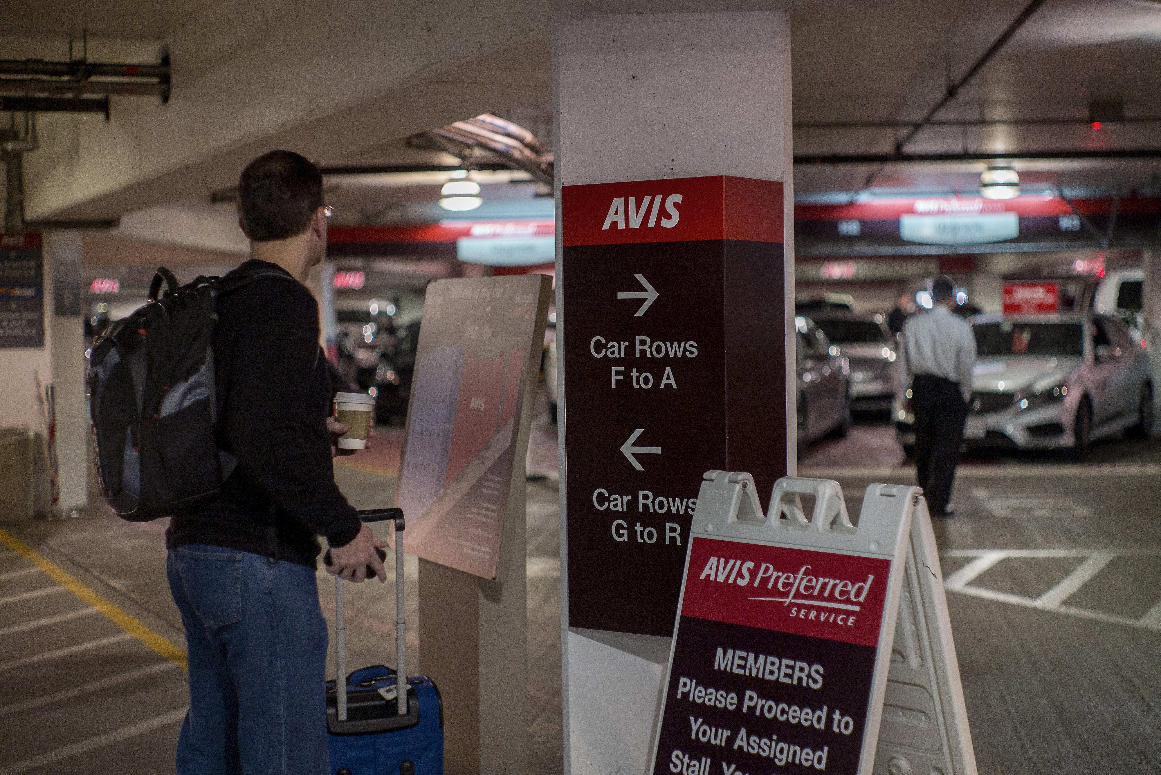 A customer waits for his car to be delivered in the garage of the Avis Budget Group Inc. at the San Francisco International Airport in San Francisco, California, U.S., on Monday, Feb. 16, 2015. Avis Budget Group Inc. is expected to release earnings figures on Feb. 18.  Photographer: David Paul Morris/Bloomberg