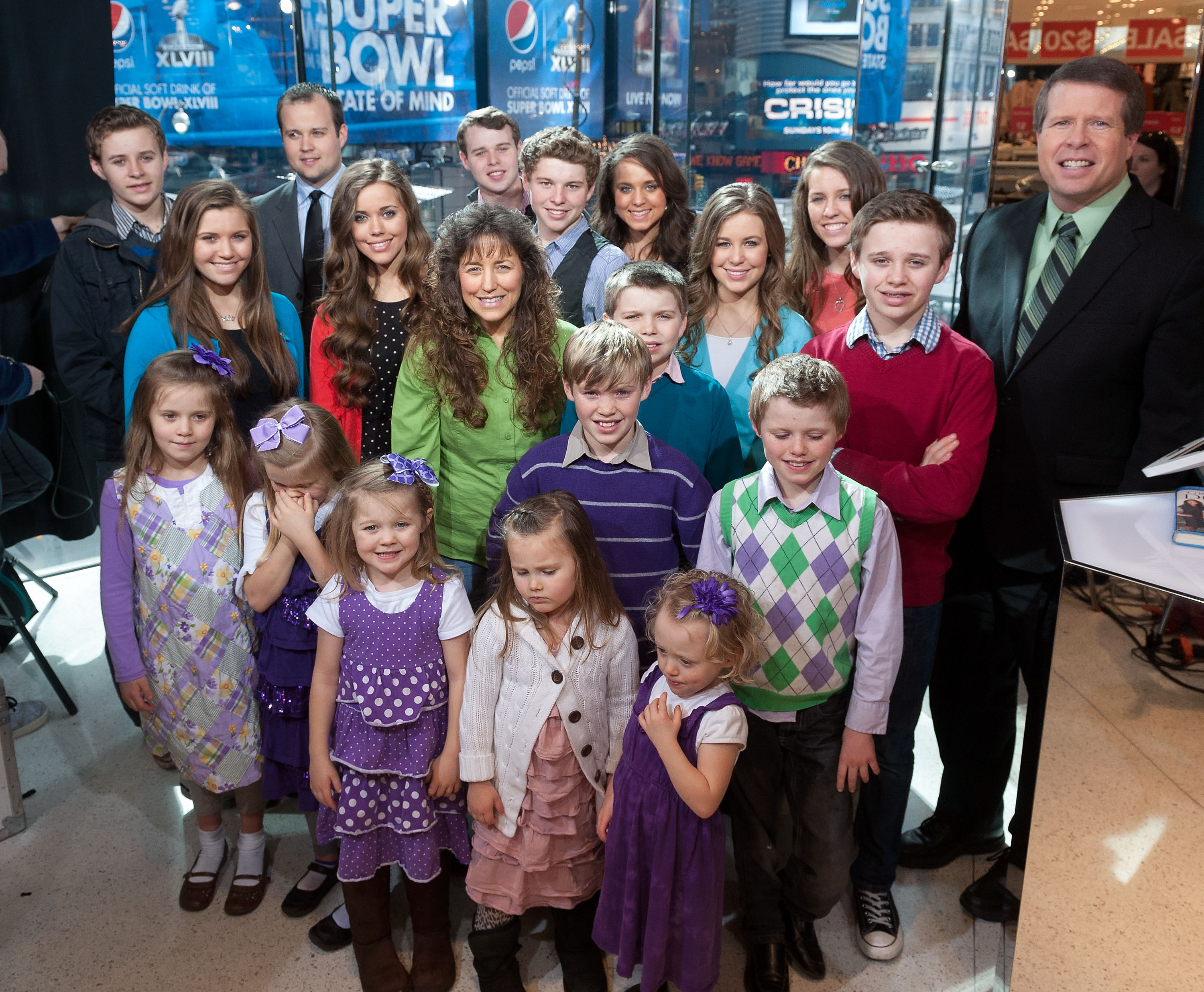 The Duggar family visits 'Extra' at their New York studios at H&M in Times Square on March 11, 2014 in New York City.