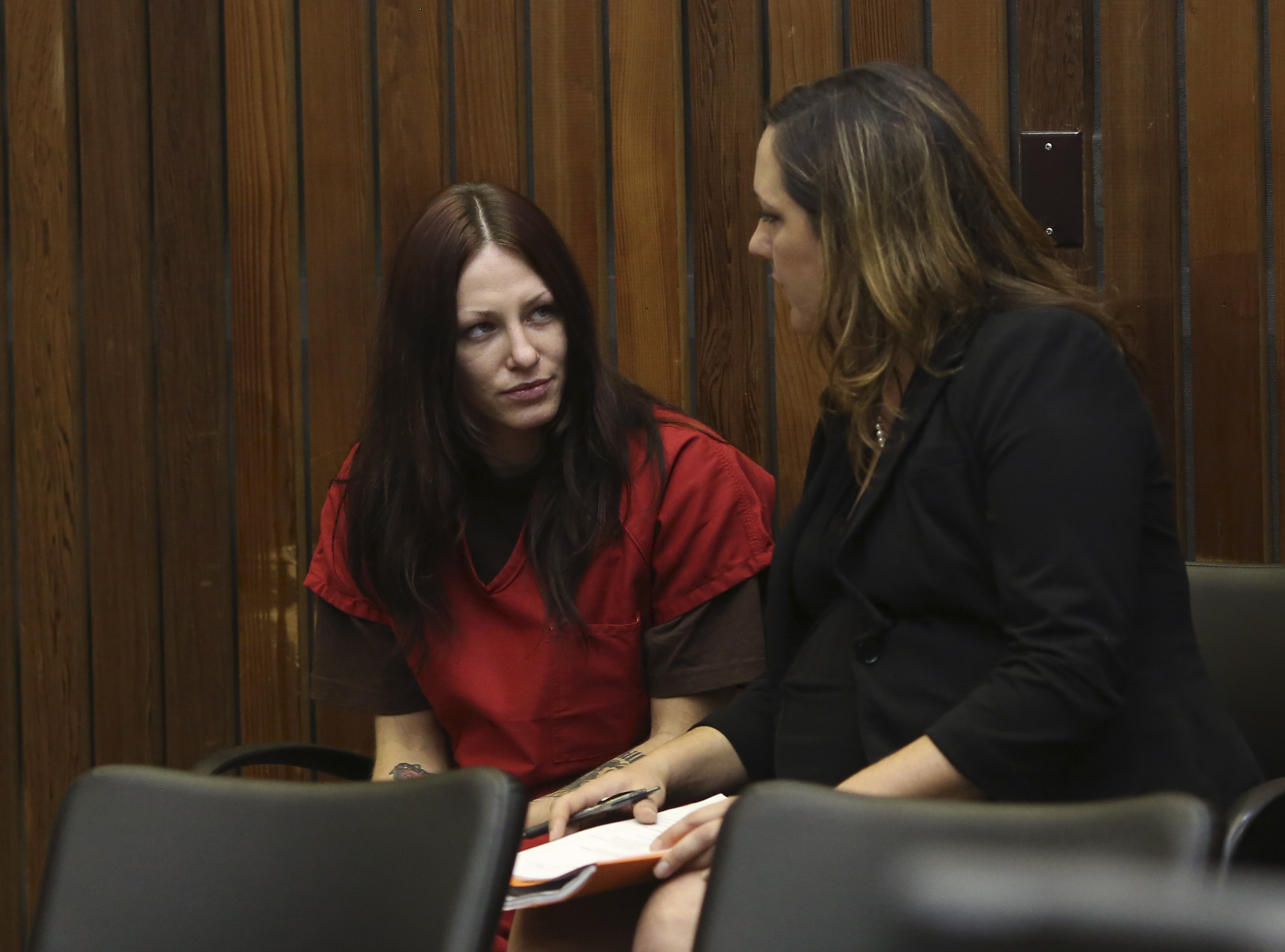 Alix Catherine Tichelman sits in the courtroom with her attorney, Athena Reis, during her arraignment in Santa Cruz