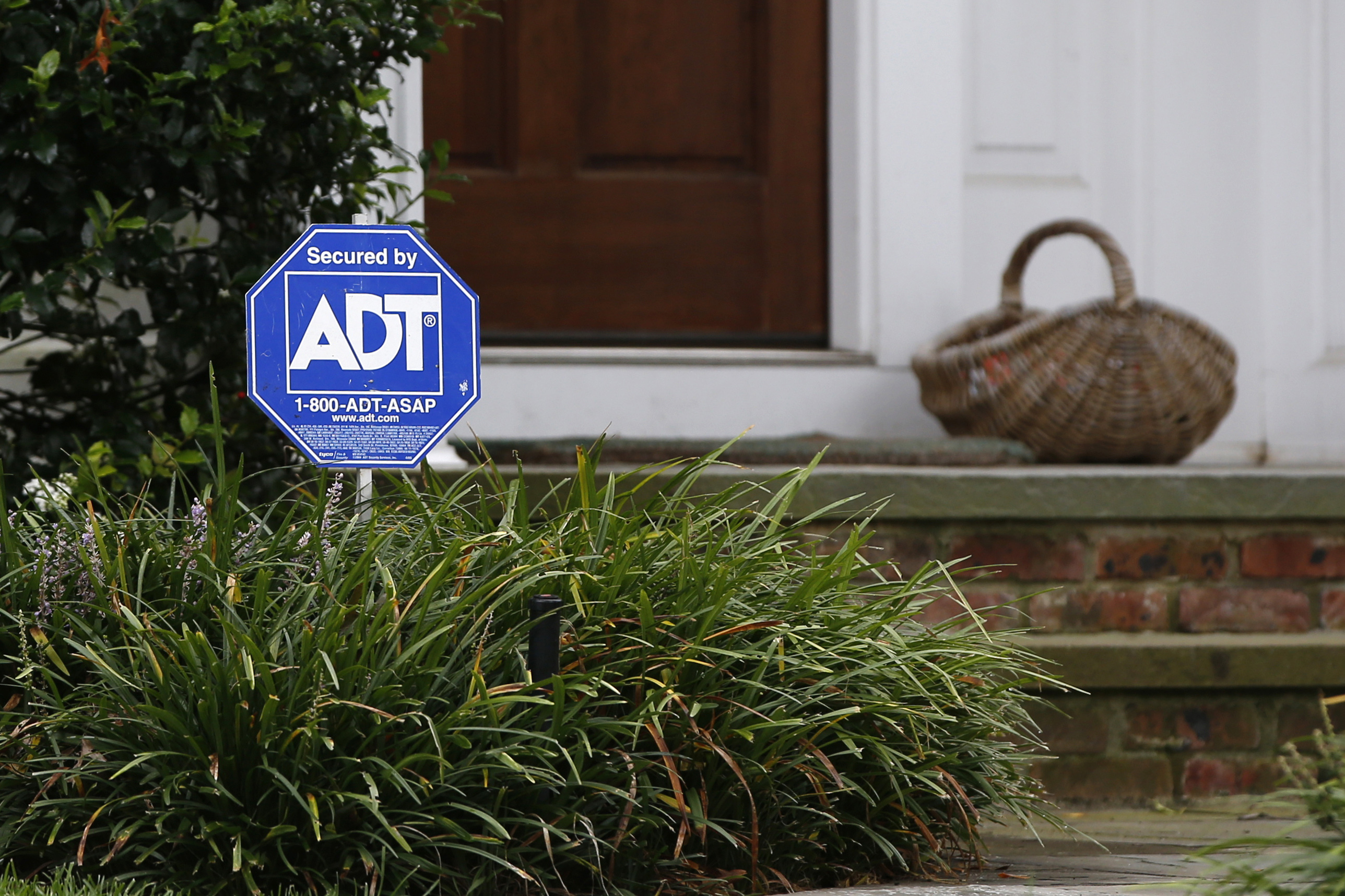 A security sign for ADT is seen outside a home in Port Washington, New York