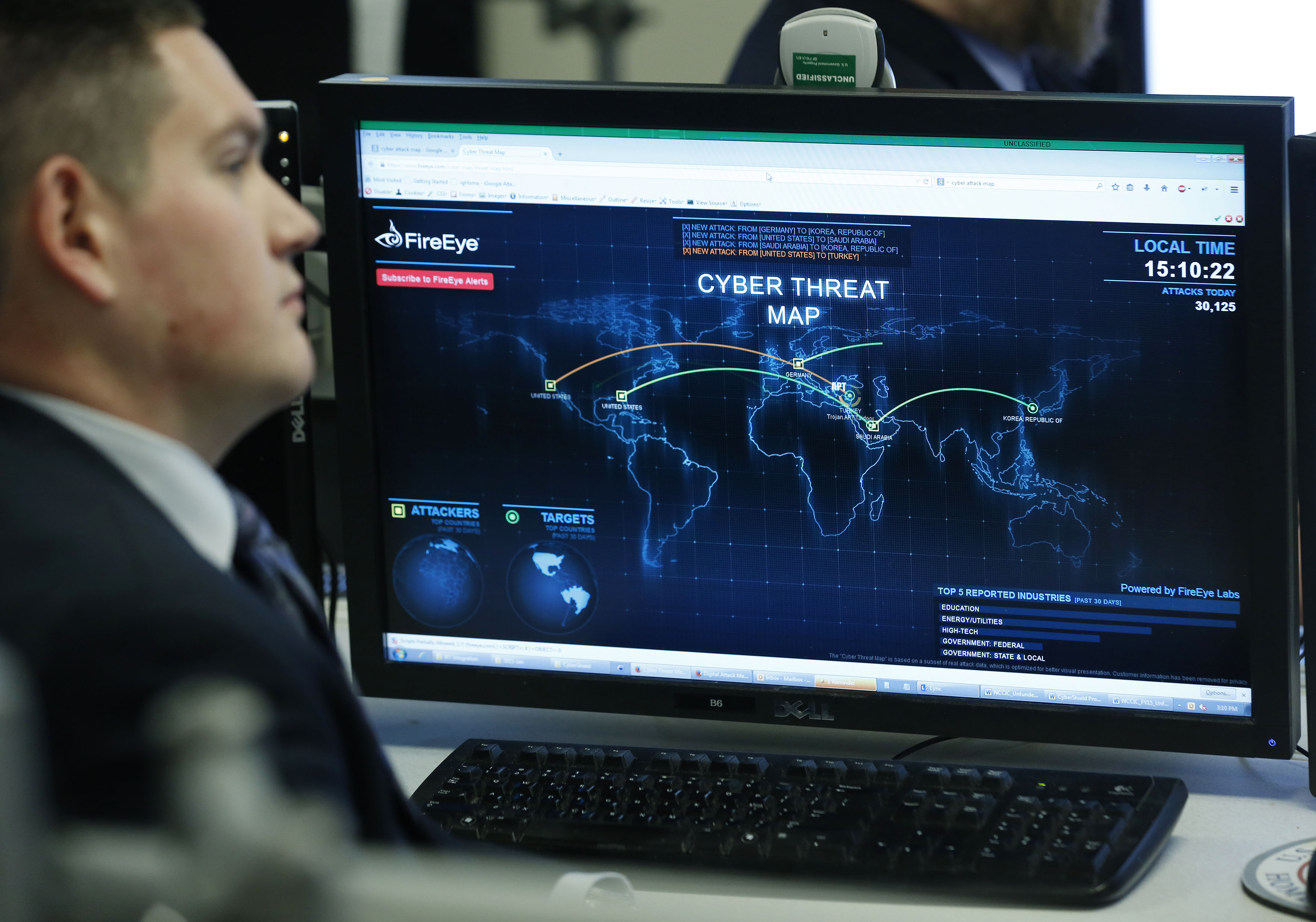 A Department of Homeland Security worker listen to U.S. President Barack Obama talk at the National Cybersecurity and Communications Integration Center in Arlington
