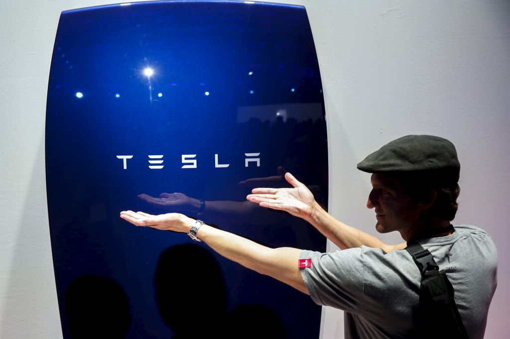 Attendees take pictures of the new Tesla Energy Powerwall Home Battery during an event at Tesla Motors in Hawthorne, California